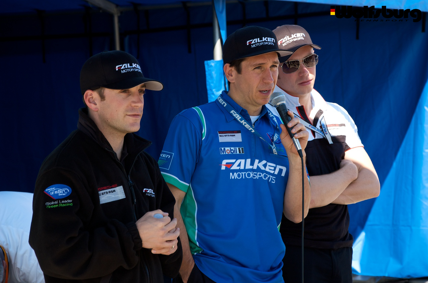 Bryan Sellers, Wolf Henzler and Patrick Pilet of Team Falken Tire talking to fans at Sebring Raceway.