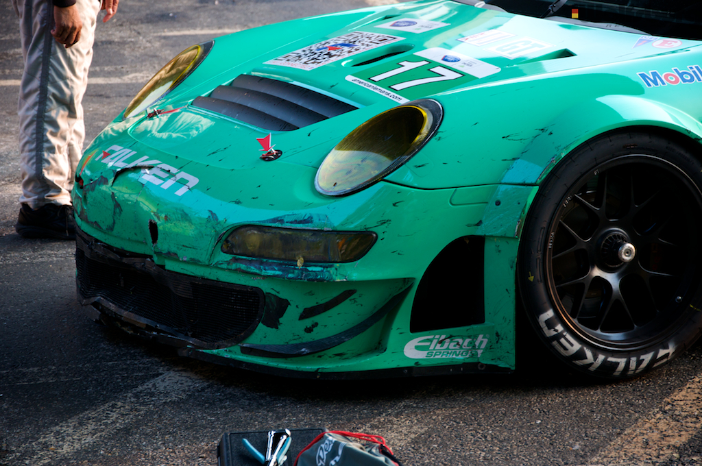The iconic teal and blue Falken Tire Porsche 911 RSR with front end damage after winning at Baltimore.