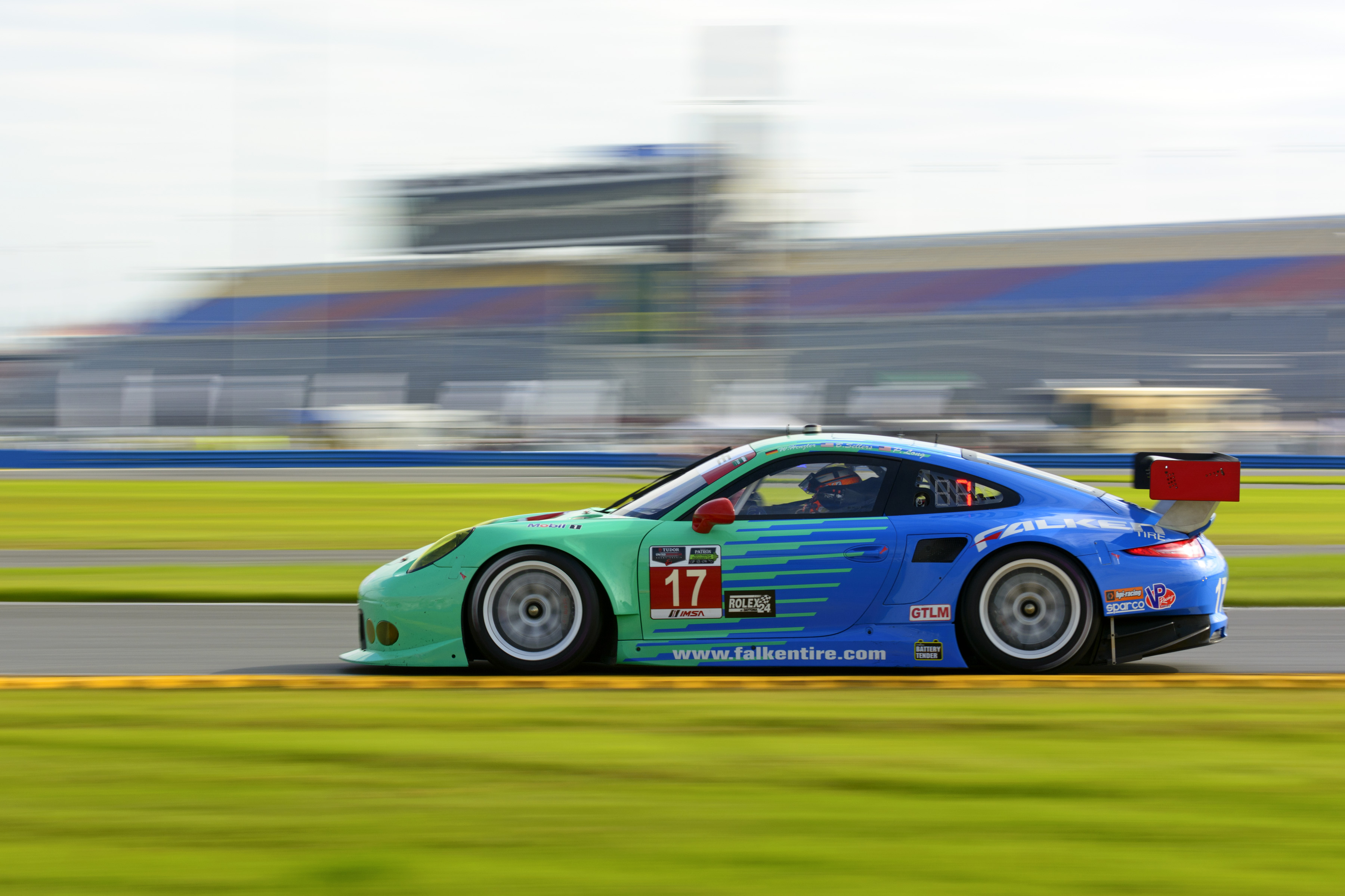 The iconic teal and blue Falken Tire Porsche 911 RSR at Daytona raceway.