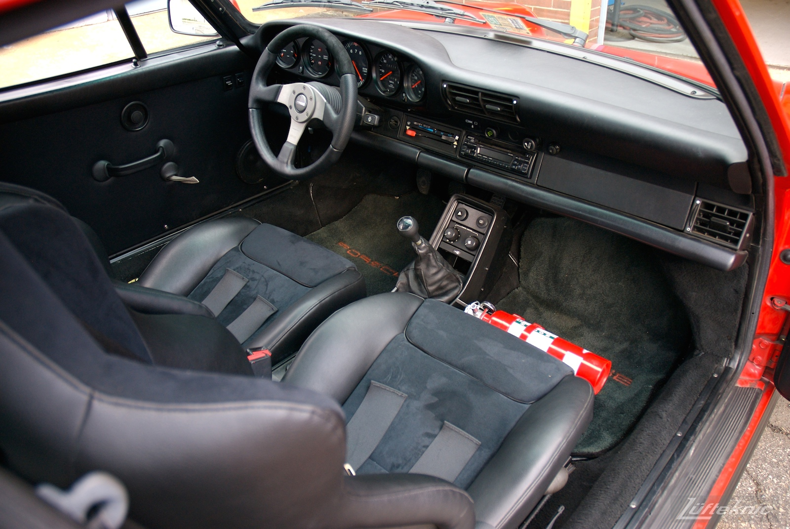 Red Porsche 930 Turbo interior.