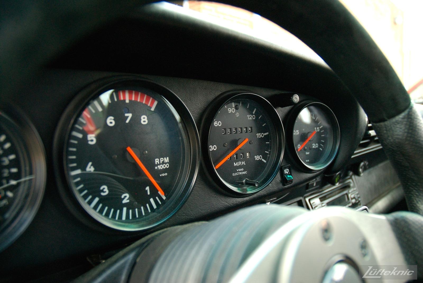 Red Porsche 930 Turbo gauges