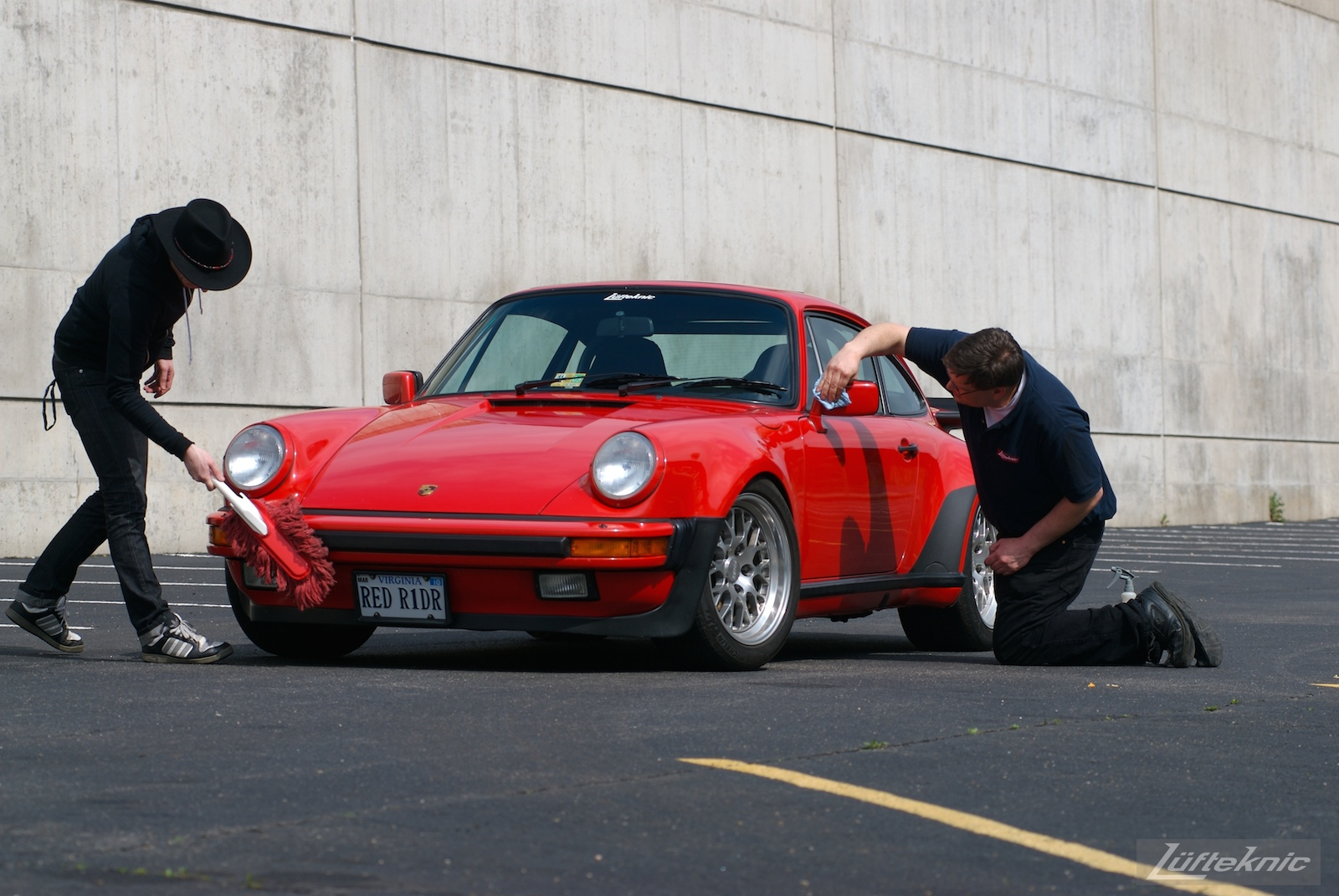Red Porsche 930 Turbo being detailed.