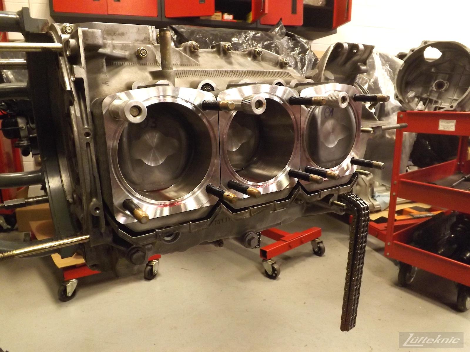 Freshly rebuilt 993 Turbo motor with pistons installed.