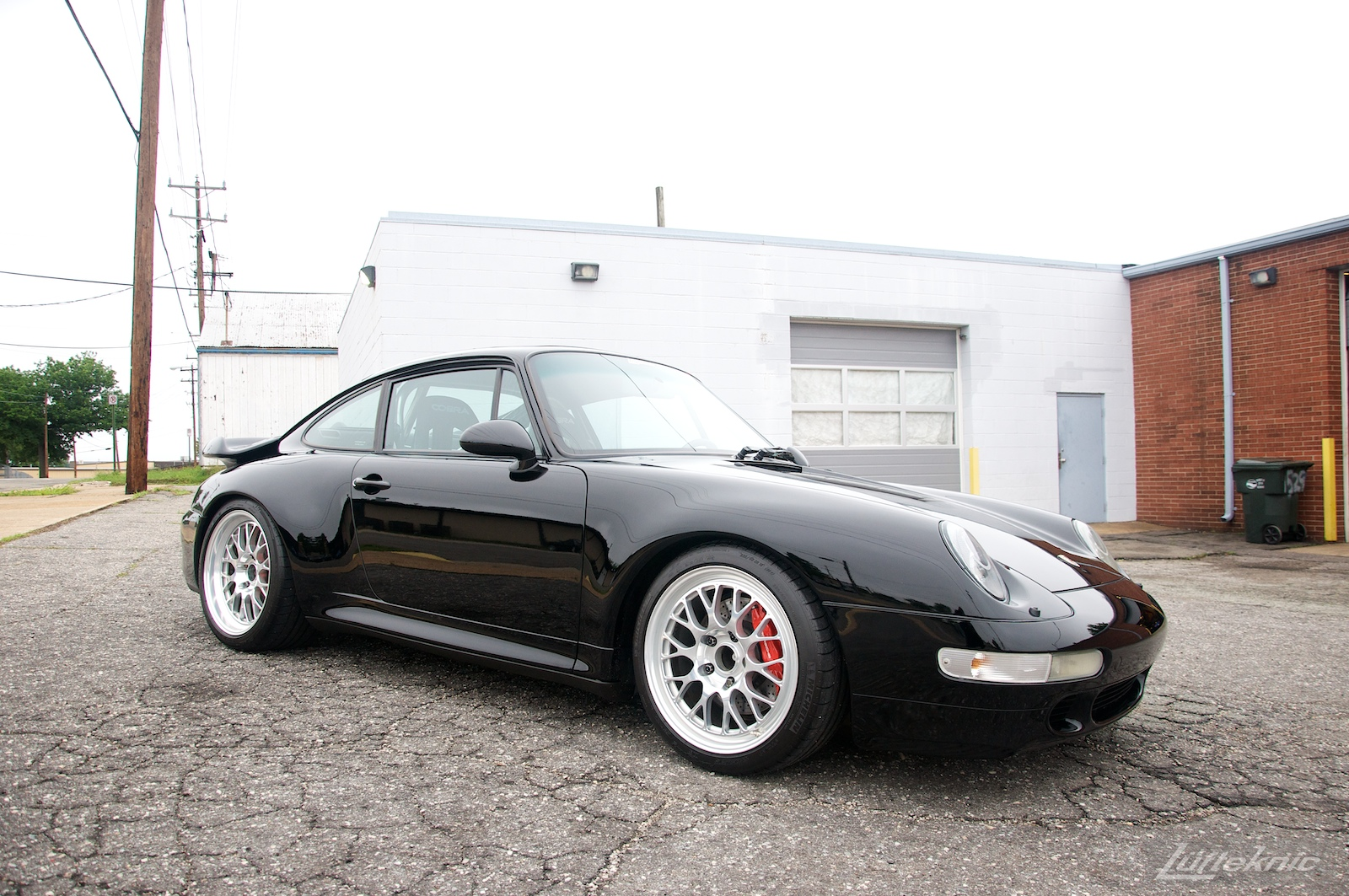 A freshly detailed shiny black 993 Turbo GT2 rear wheel drive conversion sits in the Lufteknic parking lot ready for pick up.