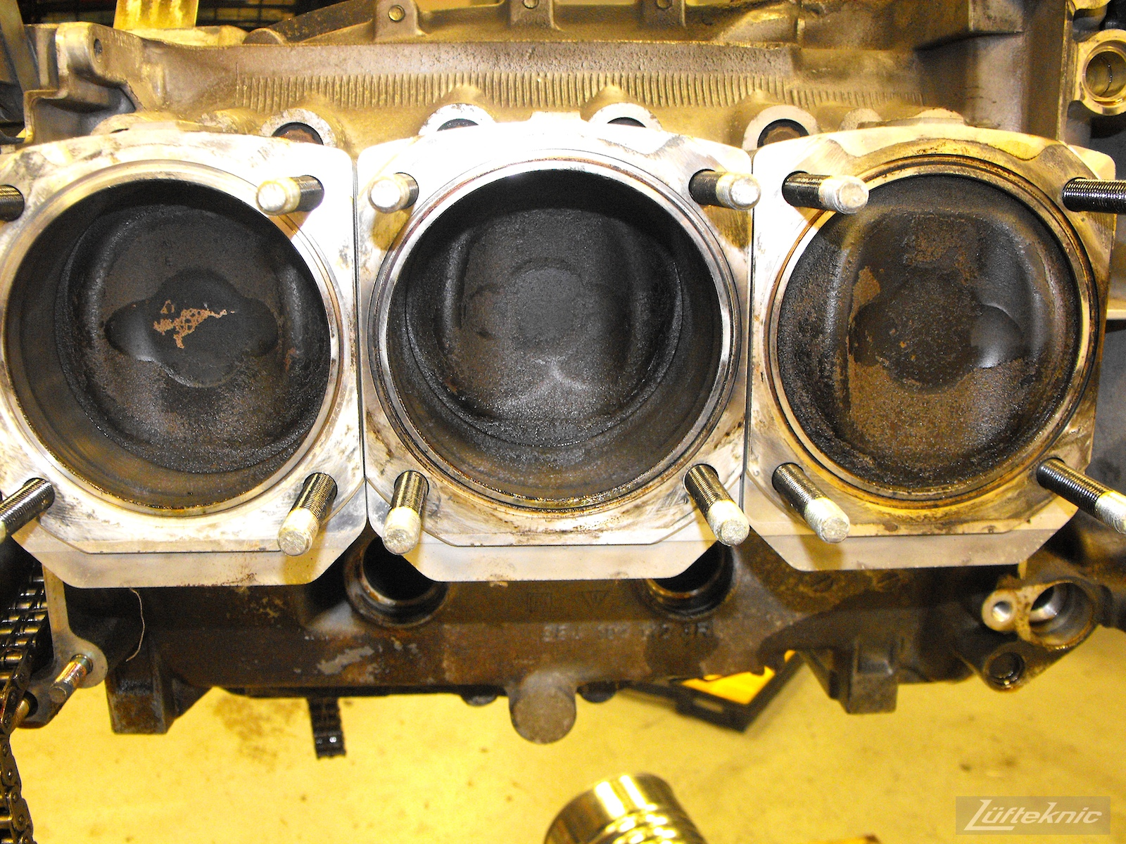 Carbon build up on top of pistons on a 993 Turbo