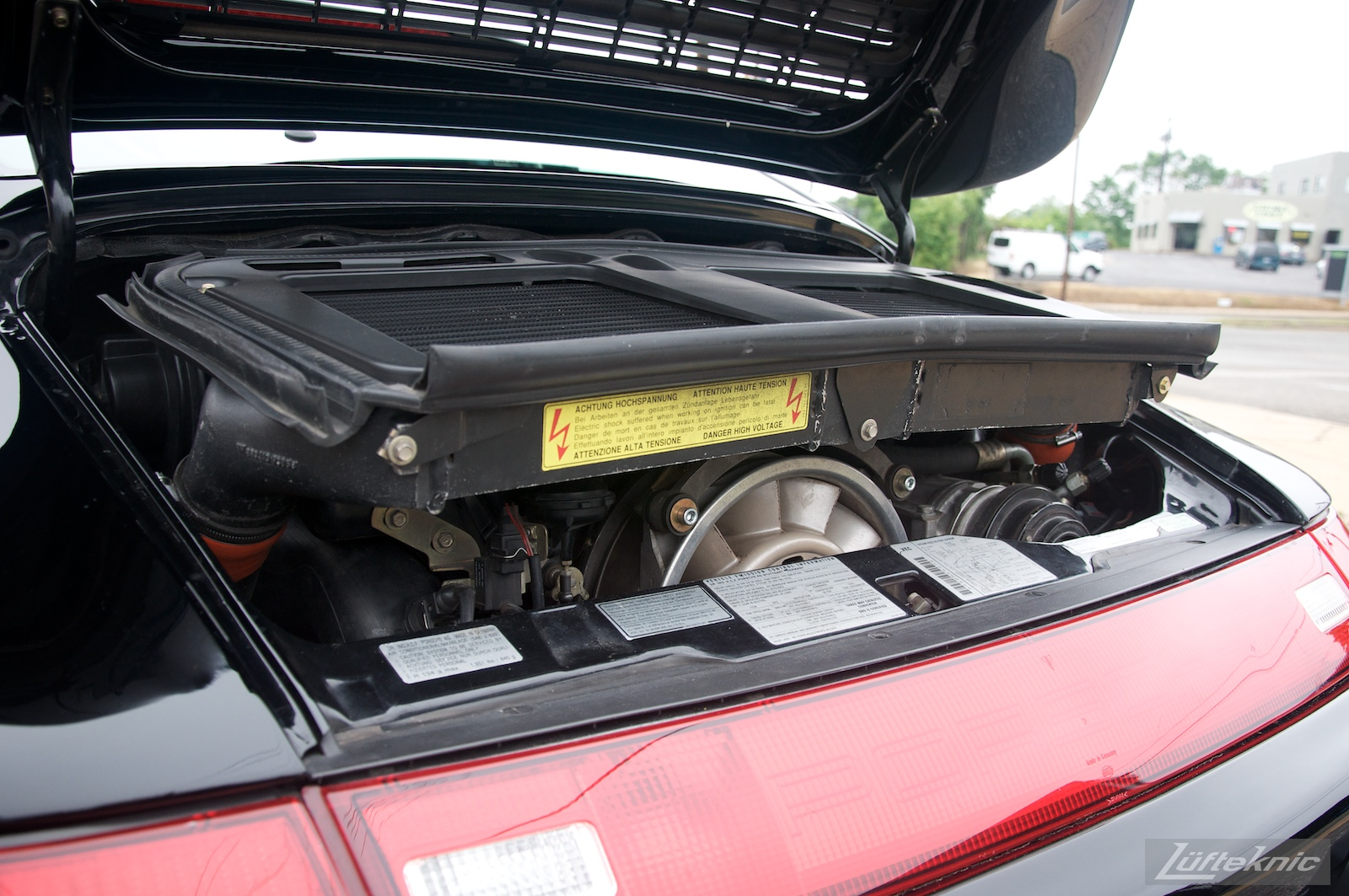 A 993 Turbo with the decklid open showing the large intercoolers.
