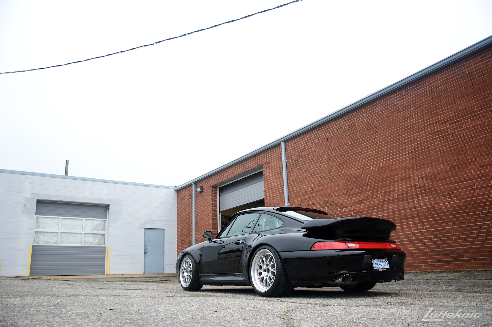 A black 993 Porsche Turbo GT2 conversion sits in the Lufteknic parking lot.