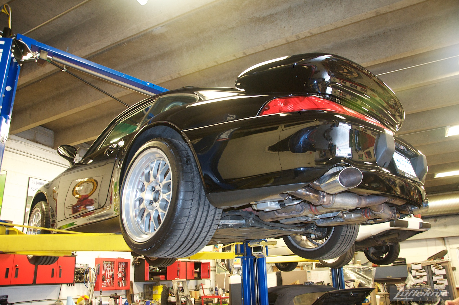 A 993 GT2 turbo conversion sits on a lift.