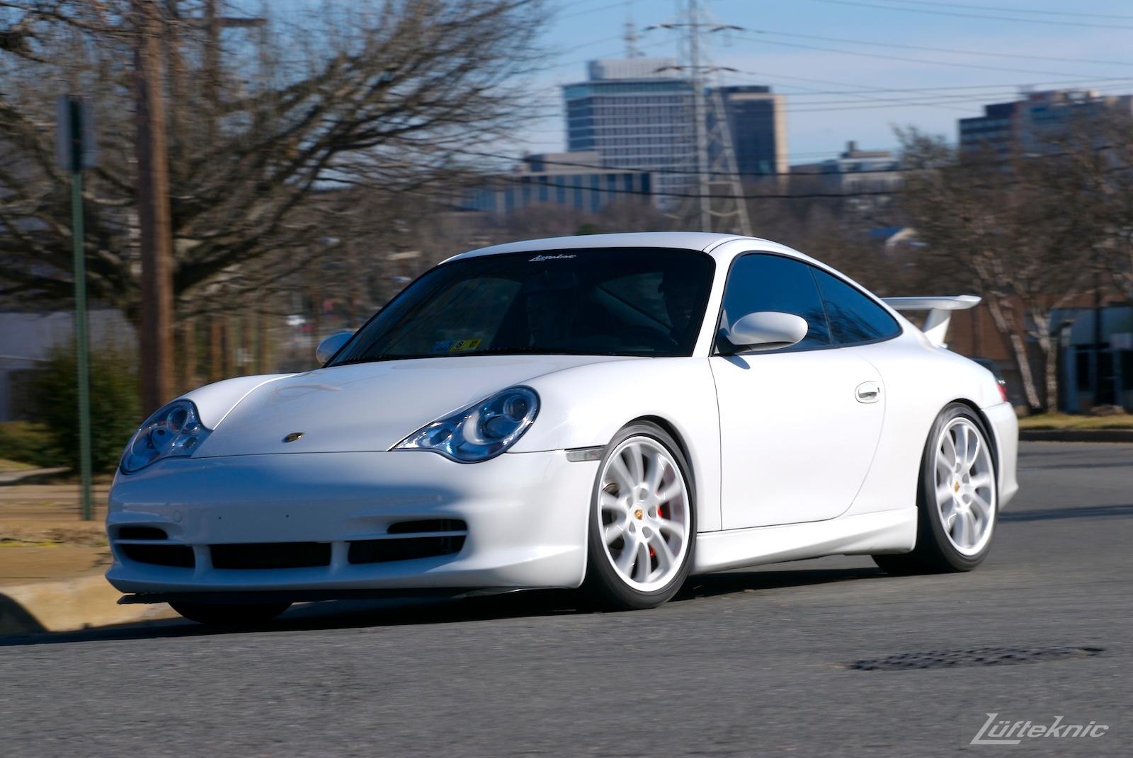 A track-prepped white Porsche 996 Gt3.