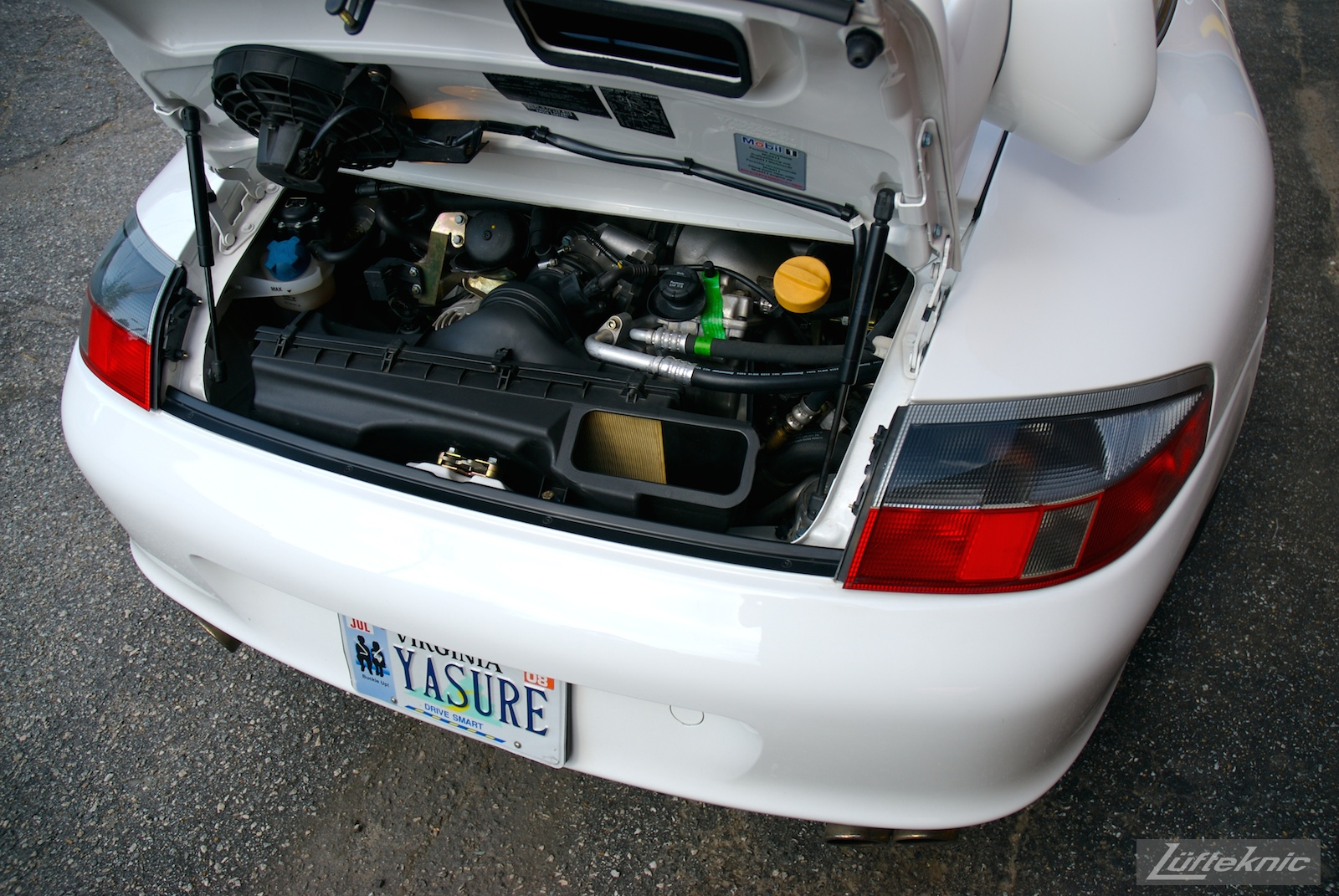 A track-prepped white Porsche 996 Gt3 with Fikse wheels.