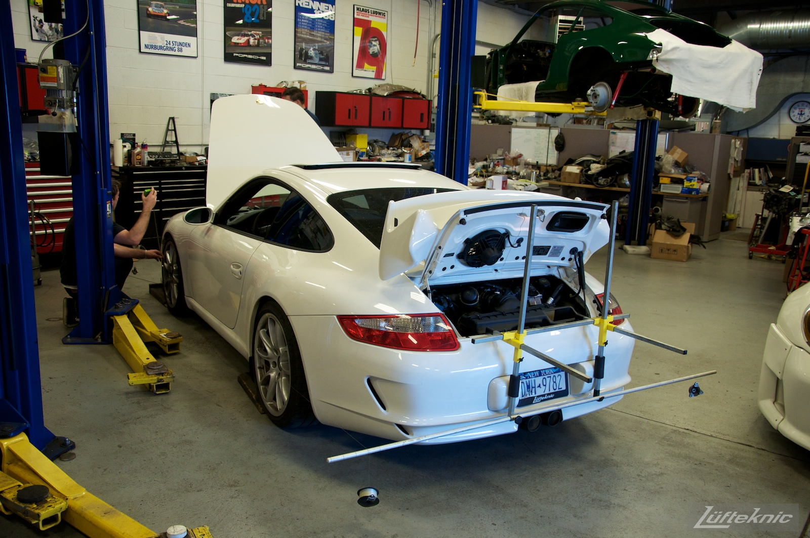 A white 993 GT3 being aligned at the Lufteknic shop.