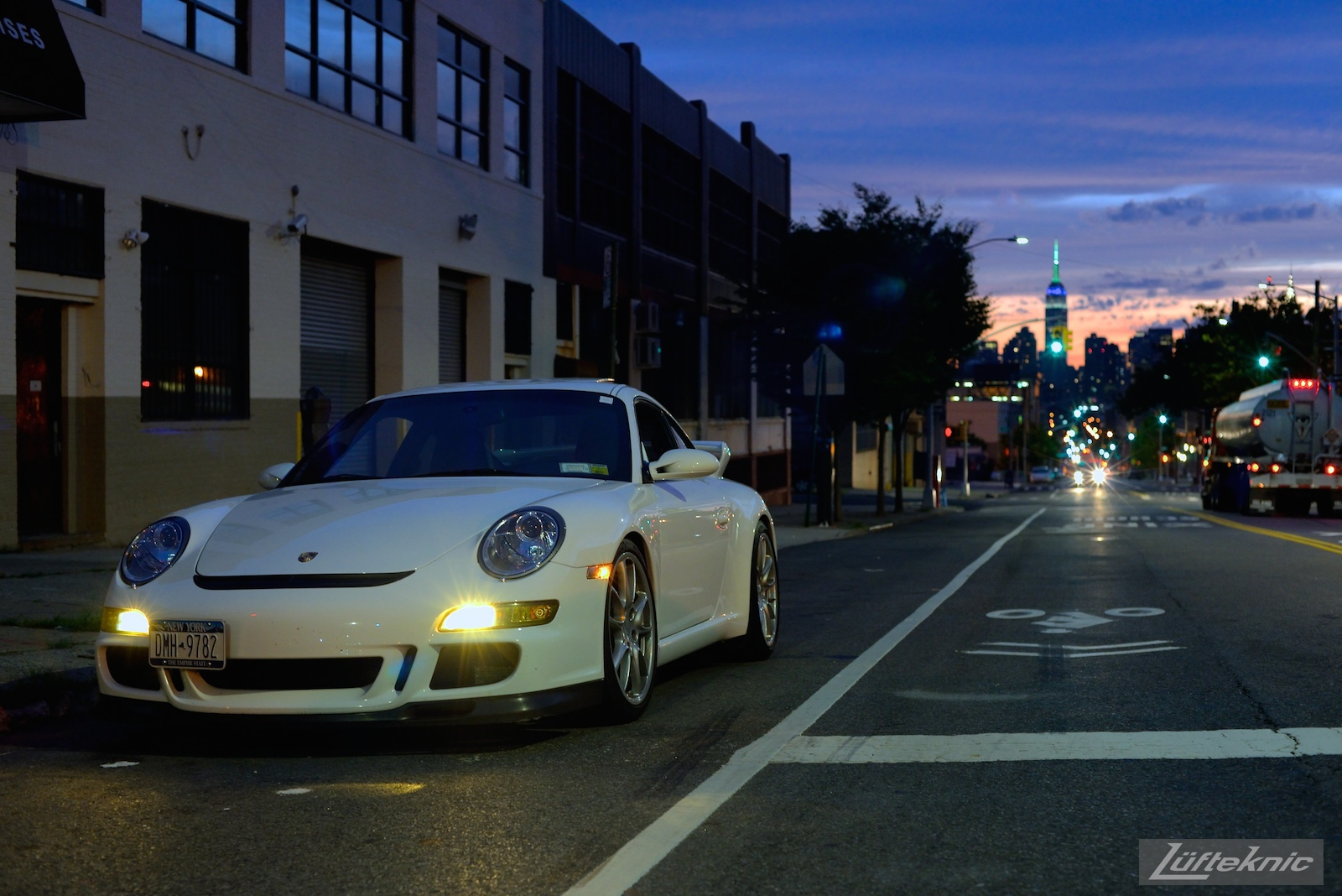 A white 997 GT3 sits on the side of the road in NYC.