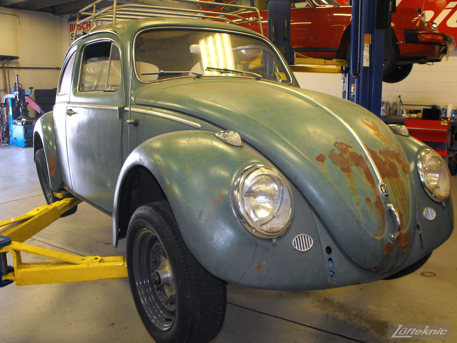 All original green 1960 Beetle with a Porsche 356 engine and brakes.