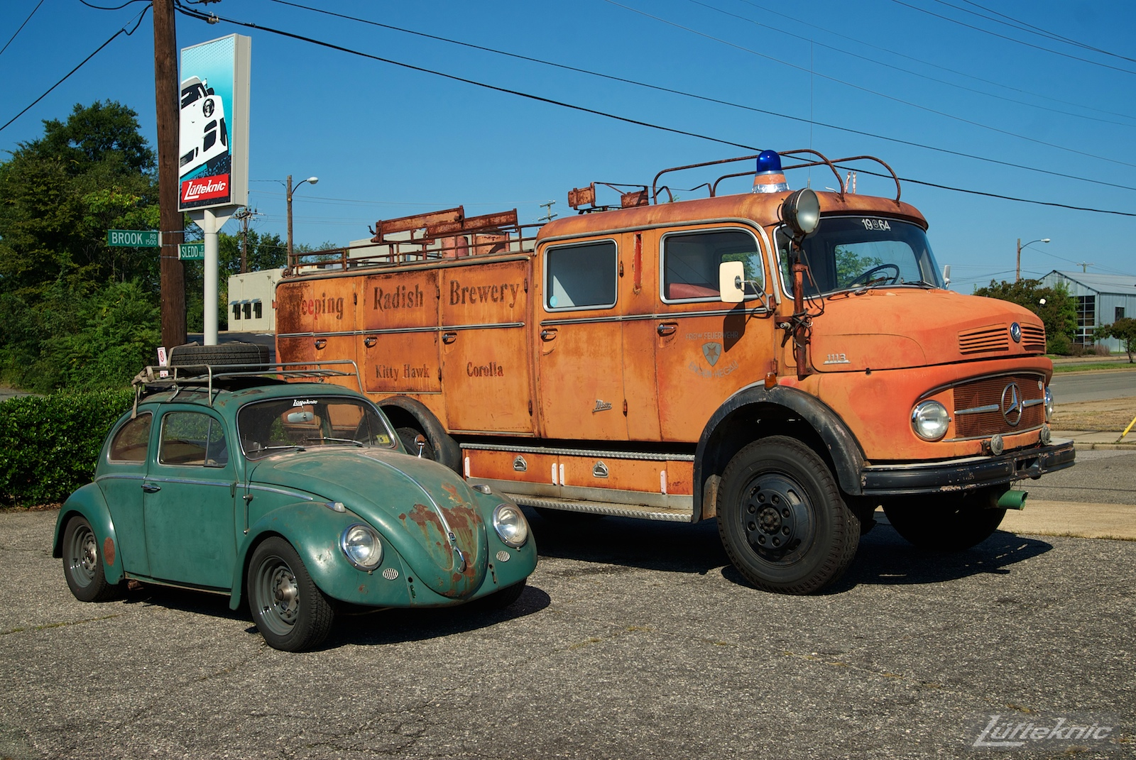 All original green 1960 Beetle with a Porsche 356 engine and brakes with fire truck.