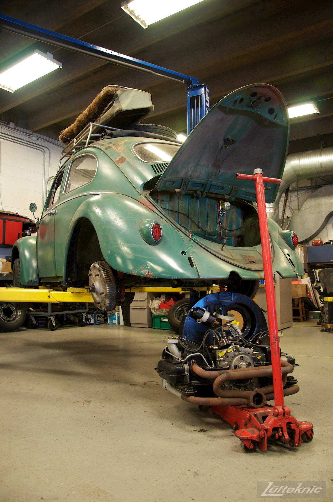 All original green 1960 Beetle with a Porsche 356 engine ready for install.