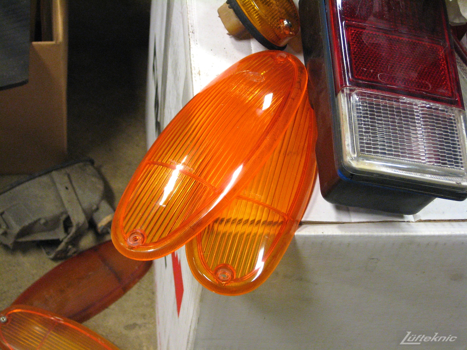 Detailed picture of fresh 914 lights prior to install on a car being restored by Lufteknic.