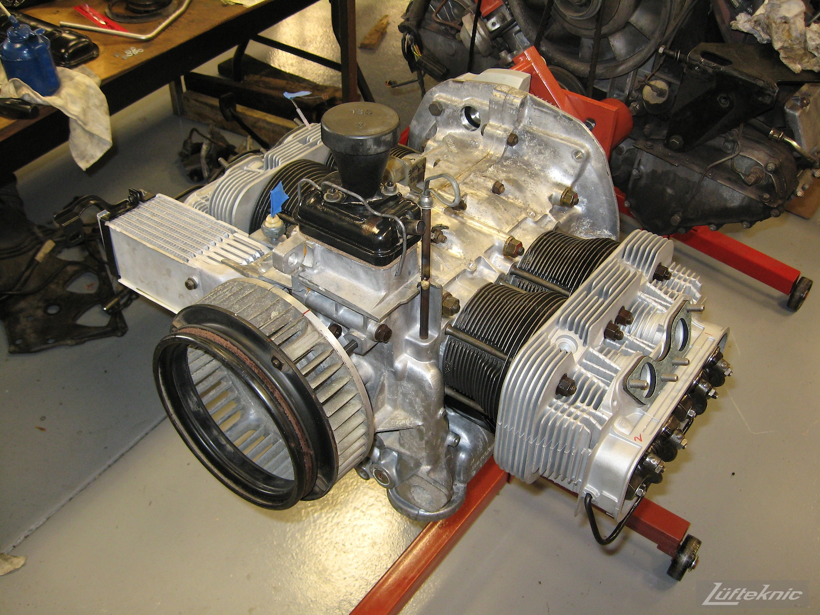 Nearly complete engine for a restored yellow Porsche 914 at Lufteknic.