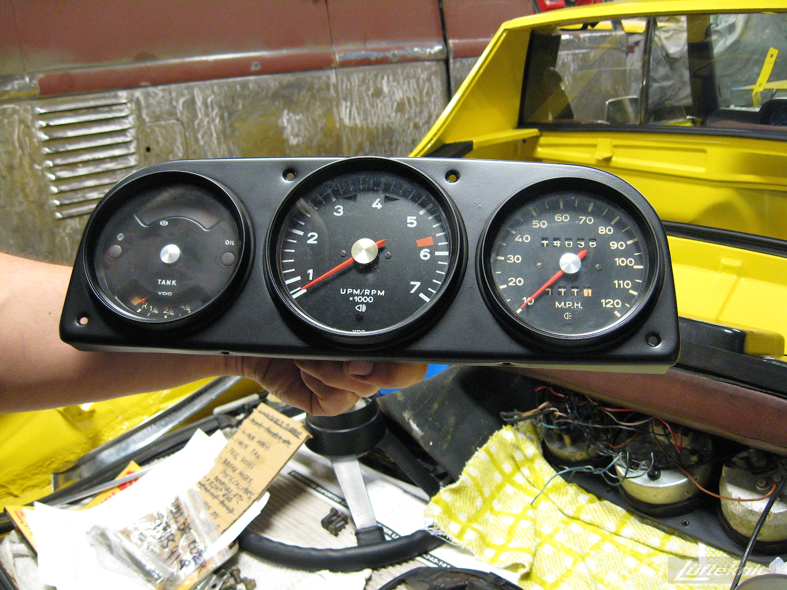 Dashboard and gauges shown for a restored yellow Porsche 914 at Lufteknic.