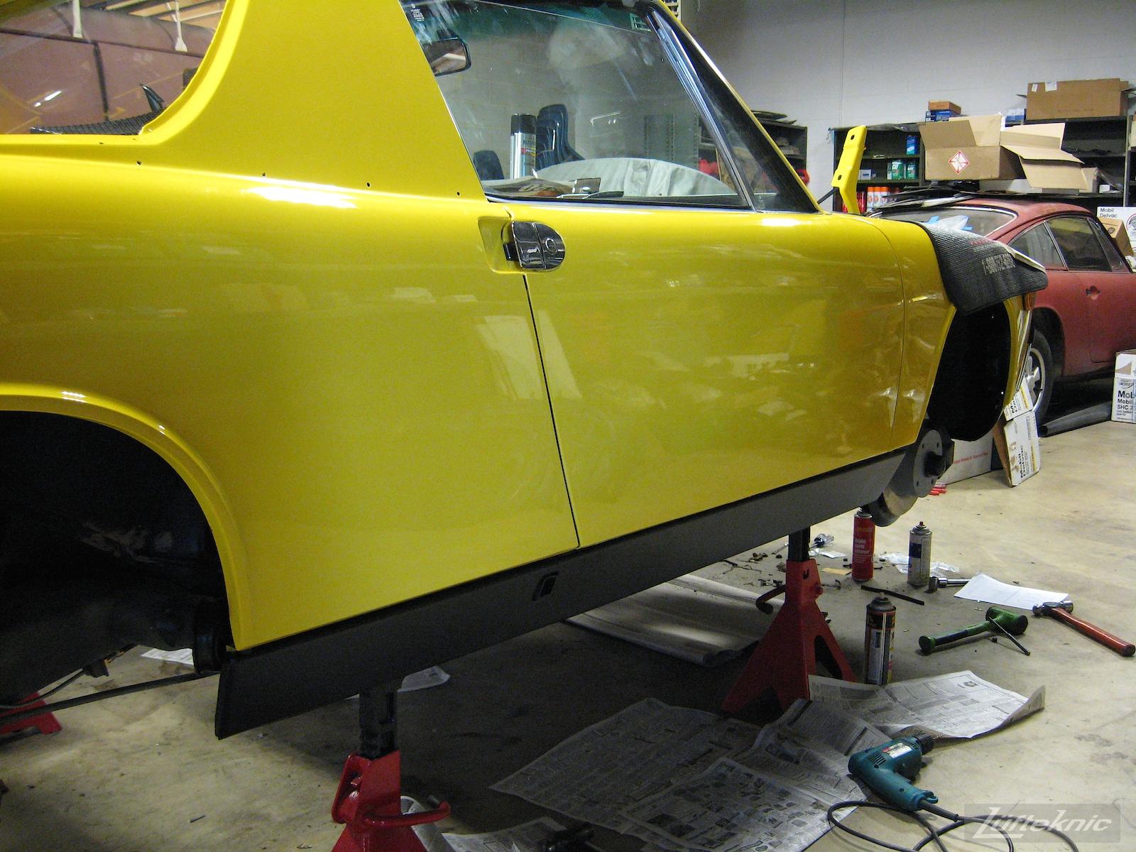 Black rocker panels shown on a restored yellow Porsche 914 at Lufteknic.