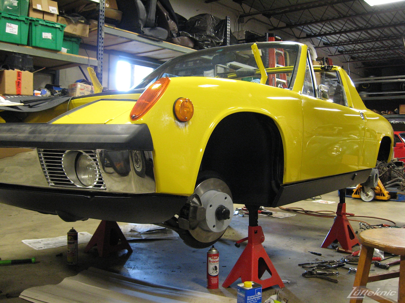 Front shot of a mostly complete restored yellow Porsche 914 at Lufteknic.