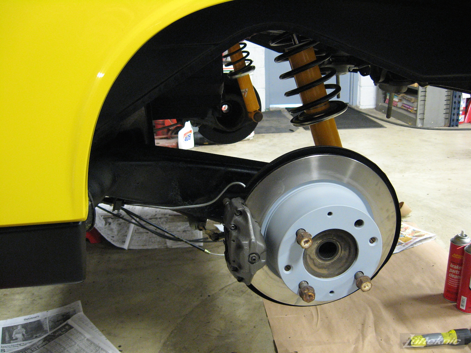 Fresh rear brakes for a restored yellow Porsche 914 at Lufteknic.