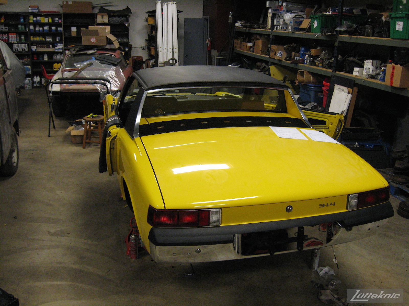 New top and nearly complete restored yellow Porsche 914 at Lufteknic.