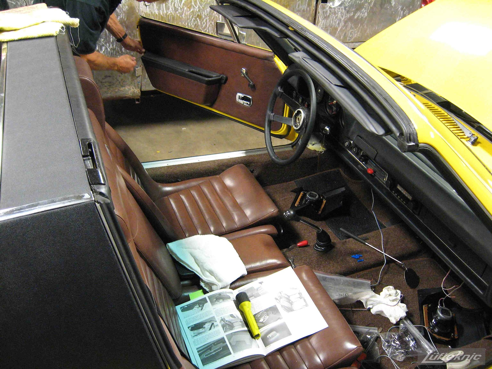 Brown original interior installed into a restored yellow Porsche 914 at Lufteknic.