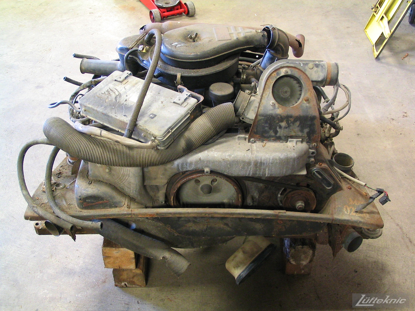 A neglected 914 engine sitting on blocks after removal from a 914 being restored.