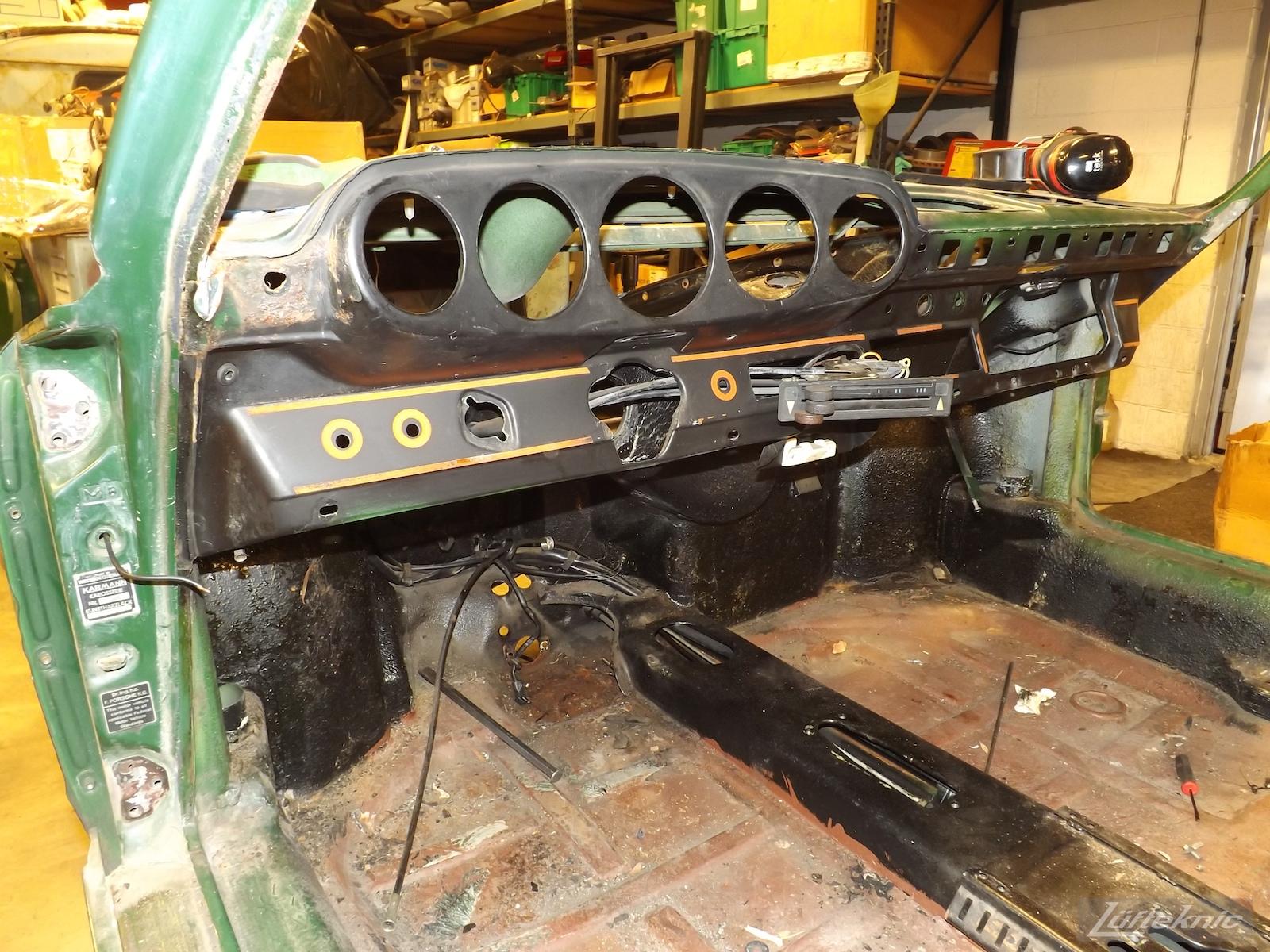 Stripped interior and dash on an Irish Green Porsche 912 undergoing restoration at Lufteknic.