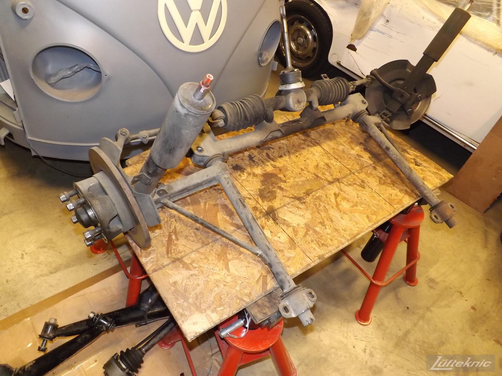 Front suspension pieces of an Irish Green Porsche 912 undergoing restoration at Lufteknic.