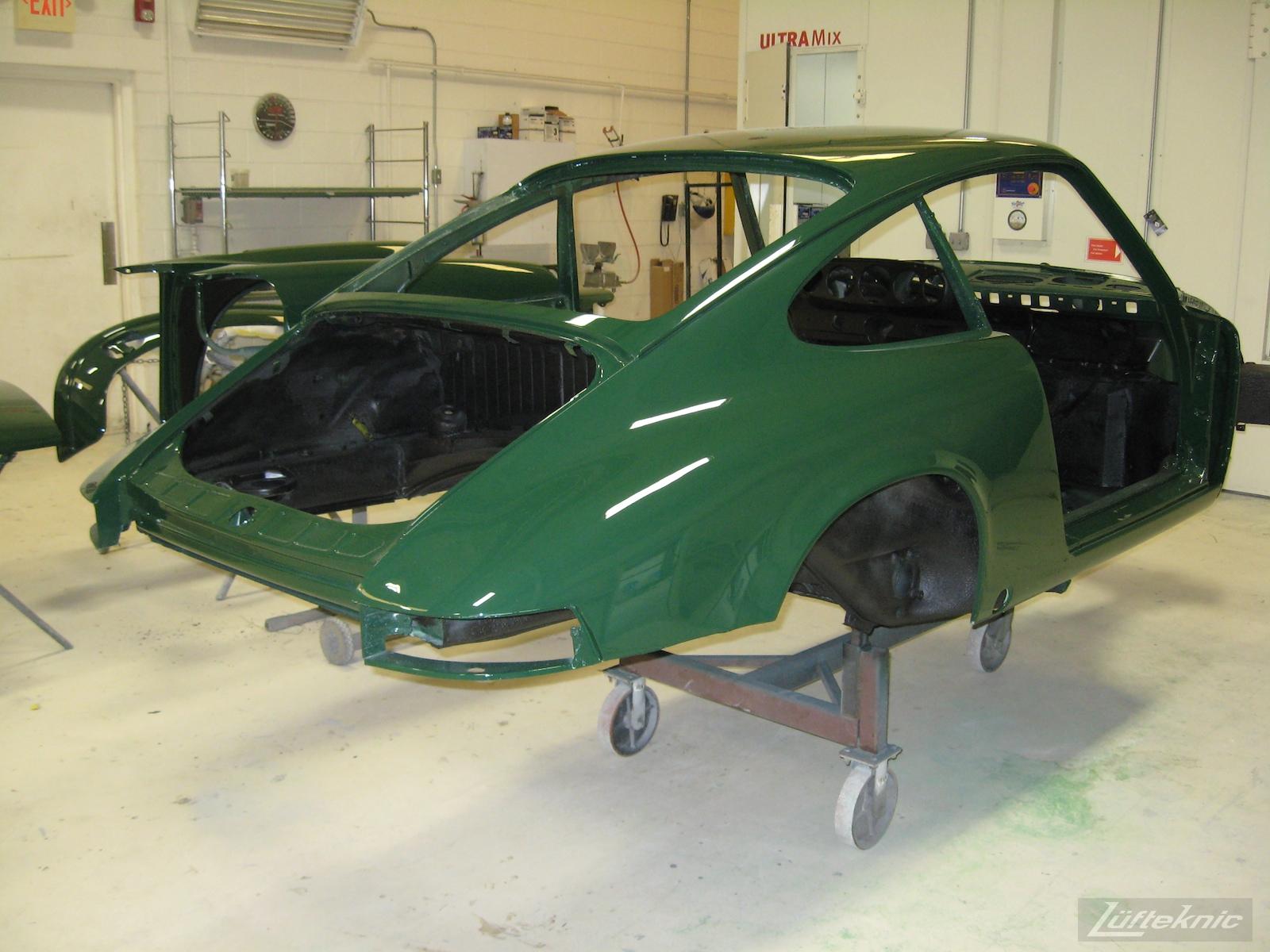 Freshly painted body shell of an Irish Green Porsche 912 undergoing restoration at Lufteknic.