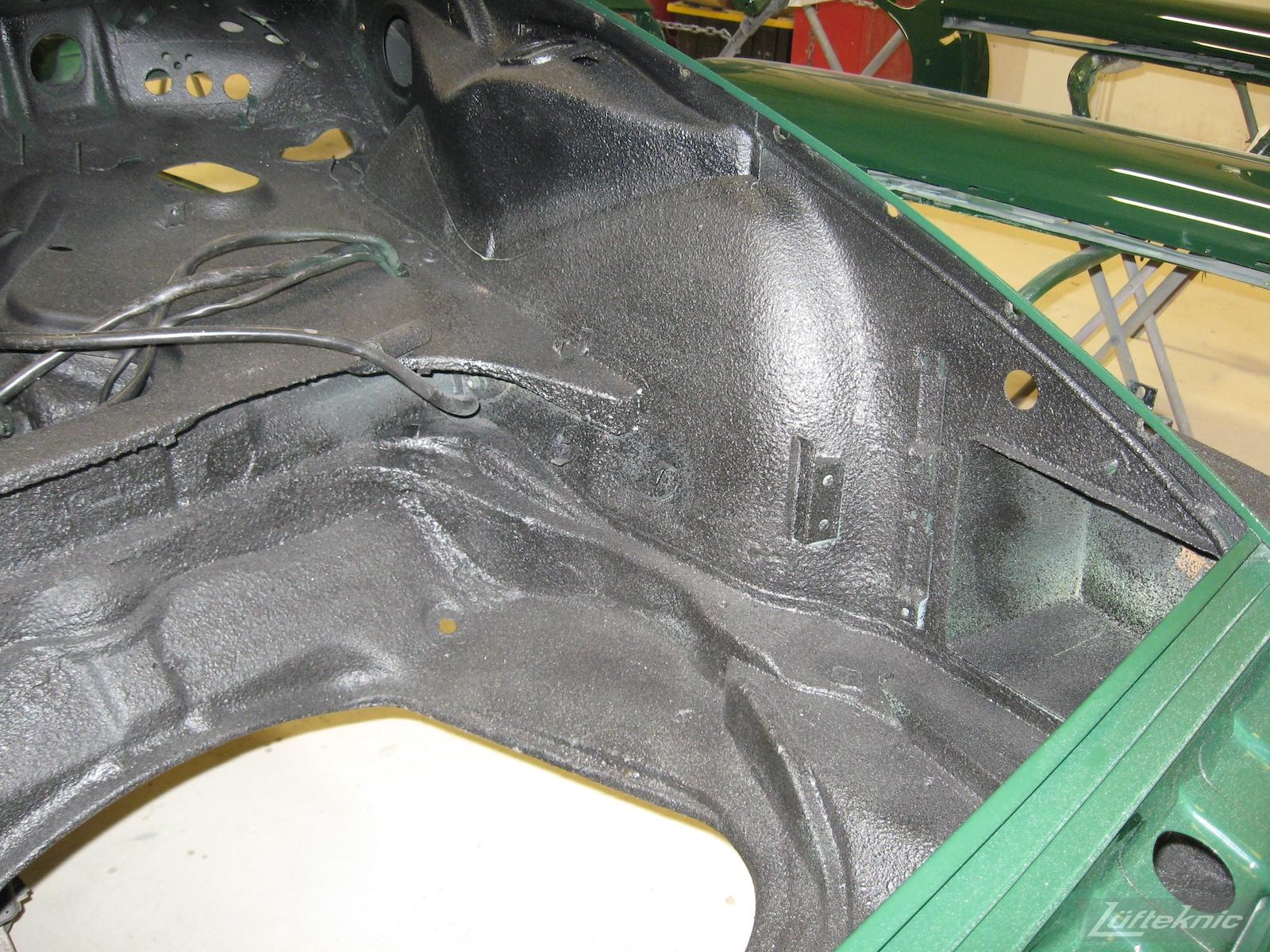 Front body pan repair after paint and undercoat of an Irish Green Porsche 912 undergoing restoration at Lufteknic.