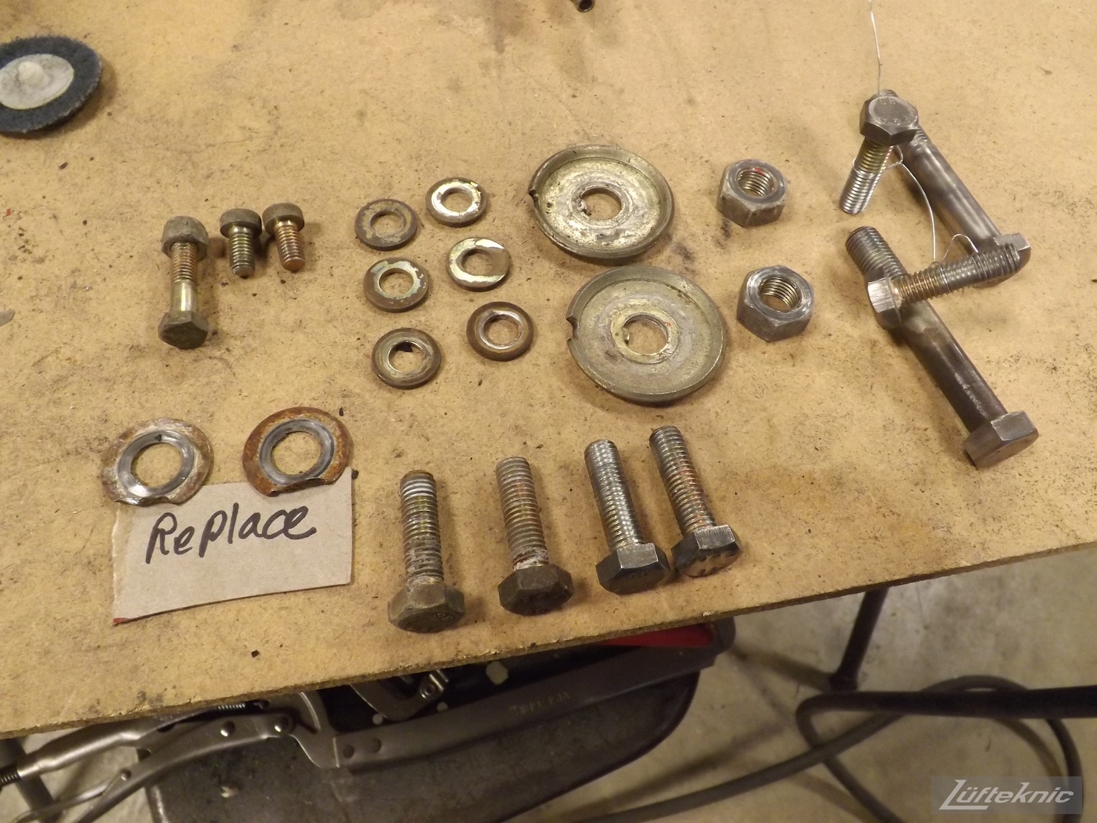 Hardware being prepped for replating for an Irish Green Porsche 912 undergoing restoration at Lufteknic.