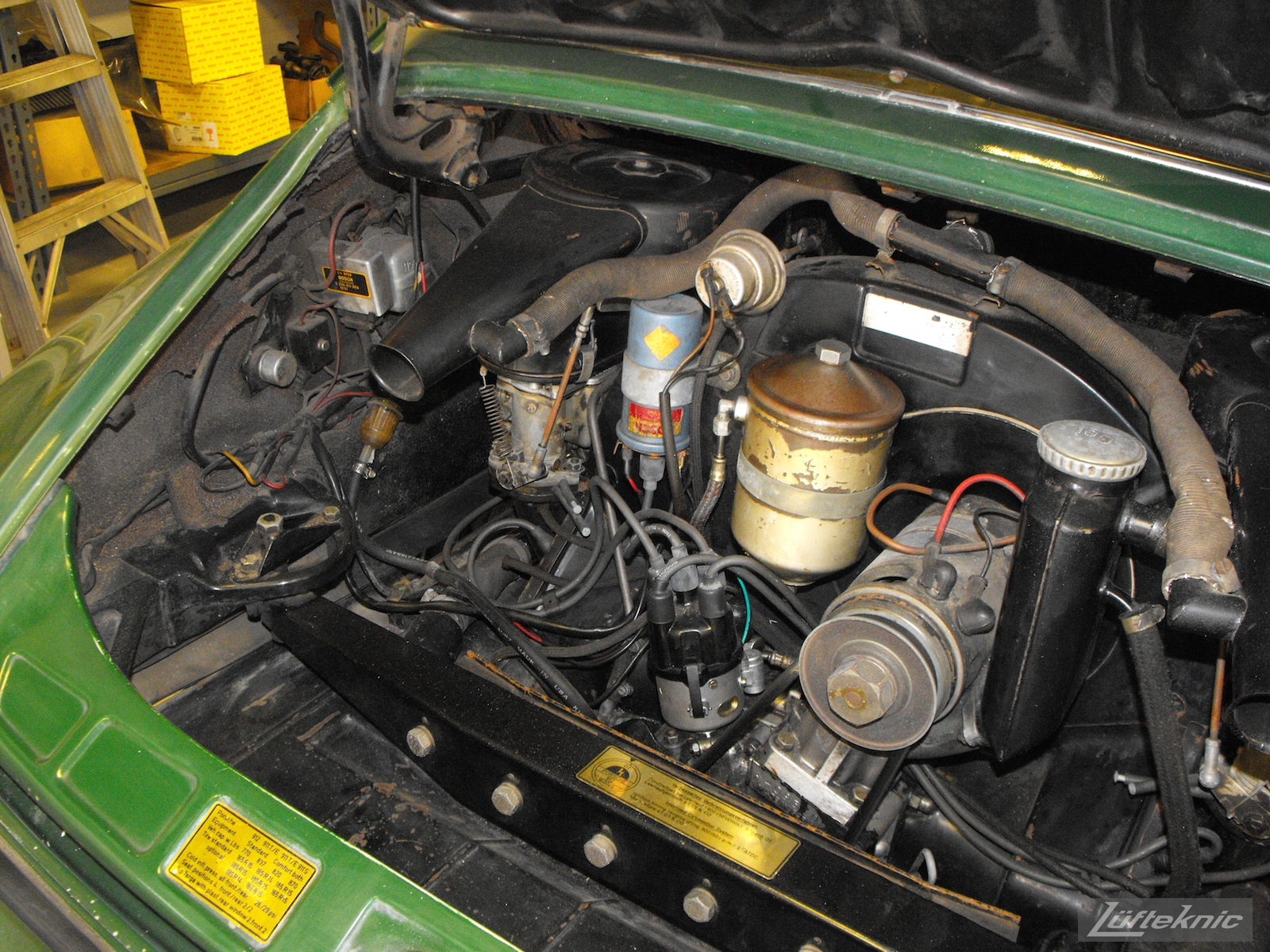 An overall picture of the engine bay of an Irish Green Porsche 912 undergoing restoration at Lufteknic.