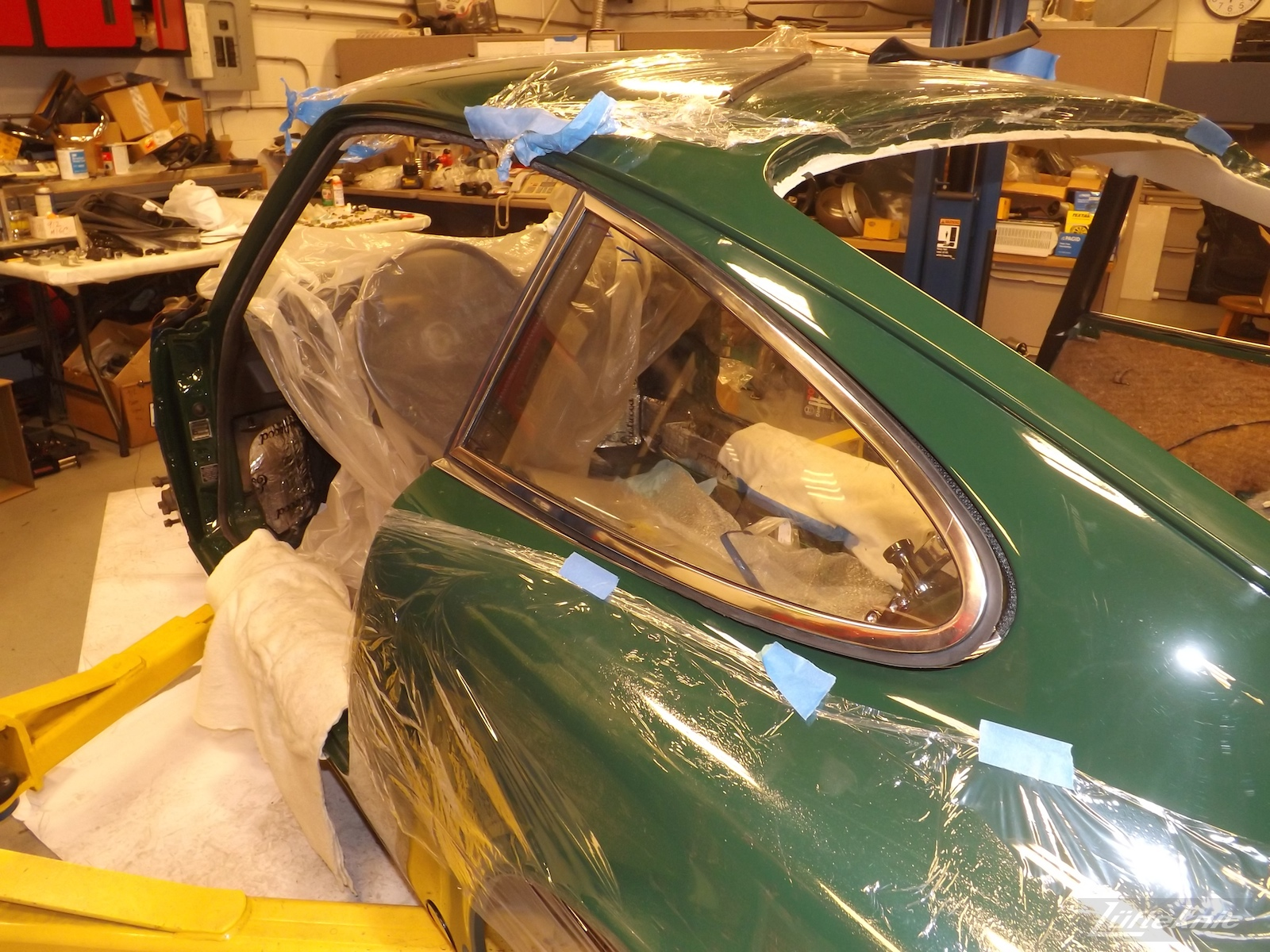 Window installation on an Irish Green Porsche 912 undergoing restoration at Lufteknic.
