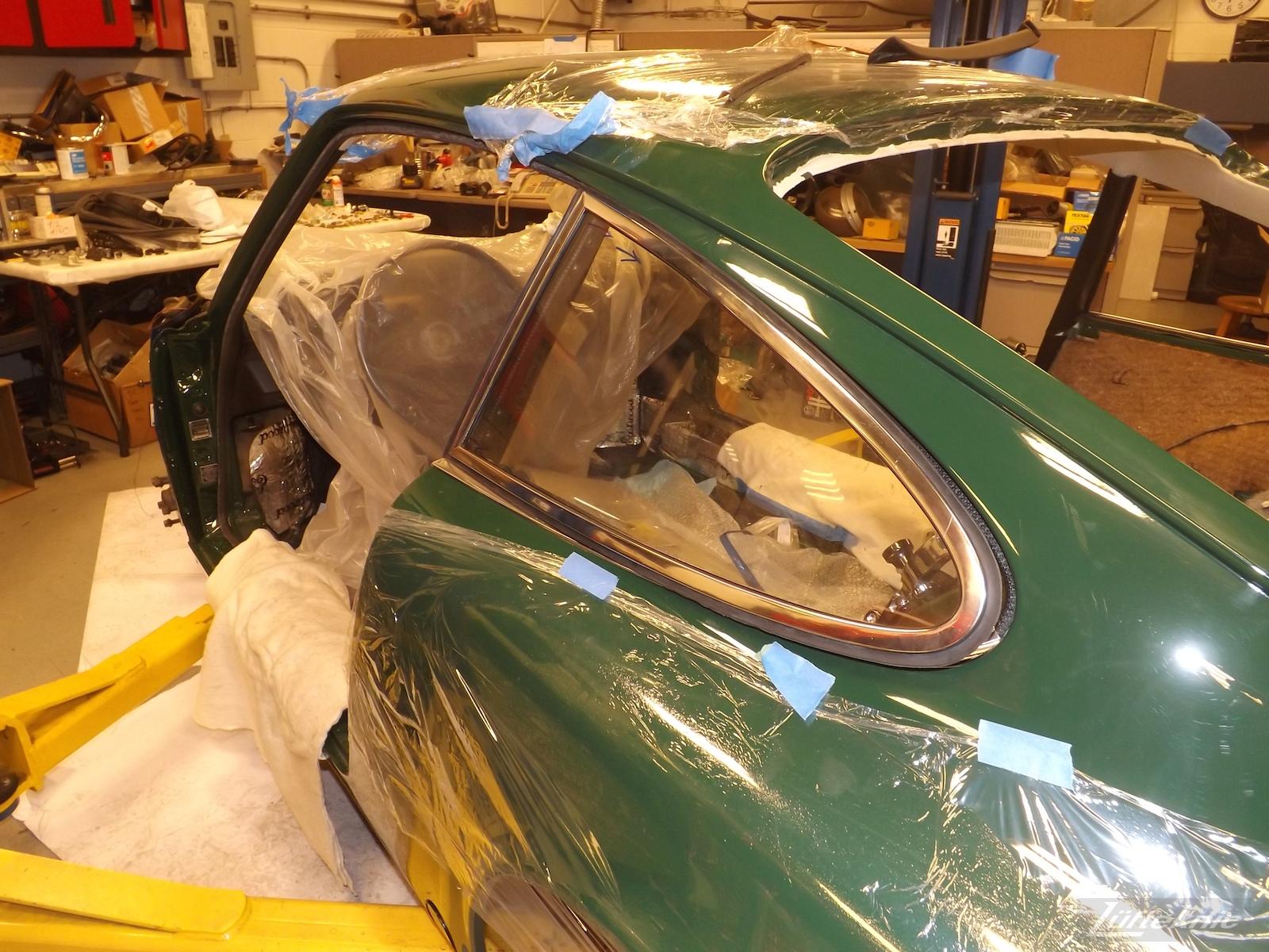 Window installation on an Irish Green Porsche 912 undergoing restoration at Lufteknic.