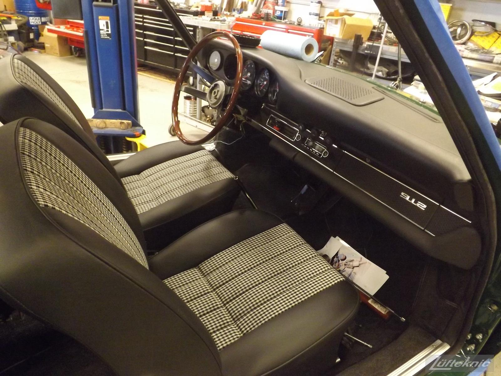Fresh seats, dashboard and wood rim steering wheel installed in an Irish Green Porsche 912 undergoing restoration at Lufteknic.
