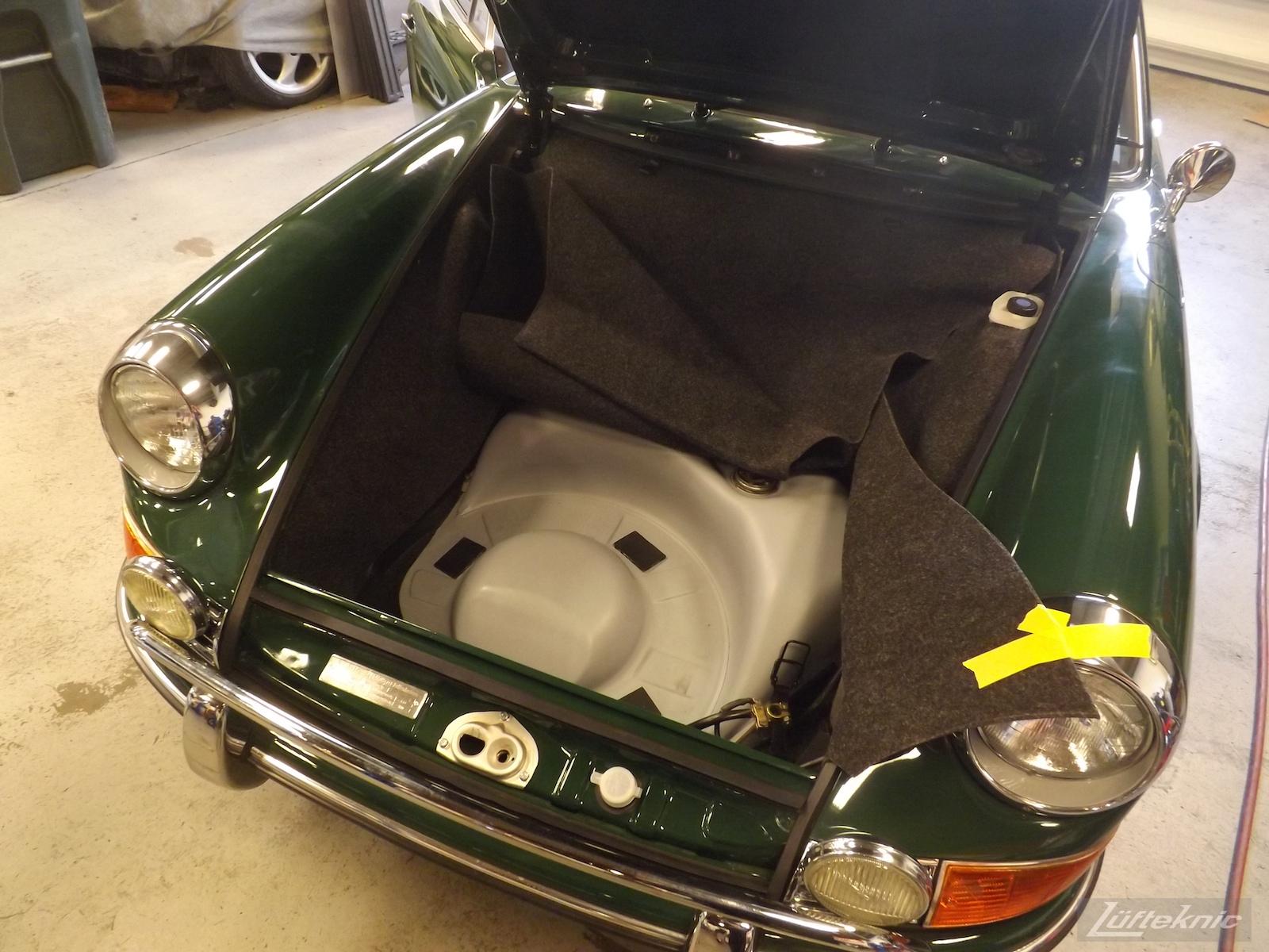 Finishing the carpet un the front trunk for an Irish Green Porsche 912 undergoing restoration at Lufteknic.