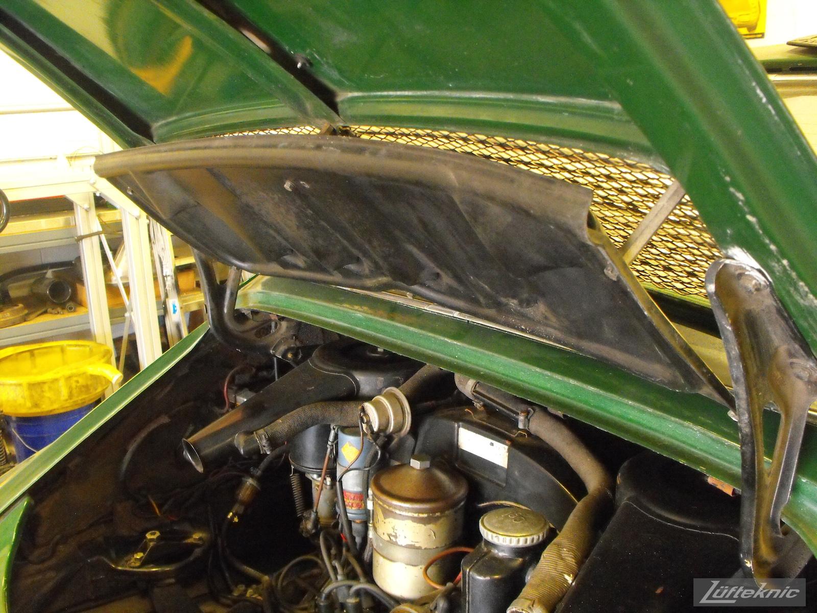 An engine decklid close up of an Irish Green Porsche 912 undergoing restoration at Lufteknic.
