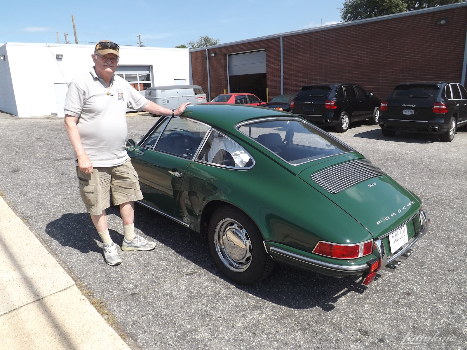 A freshly restored Irish Green Porsche 912 and the proud owner pictured in the Lufteknic parking lot.