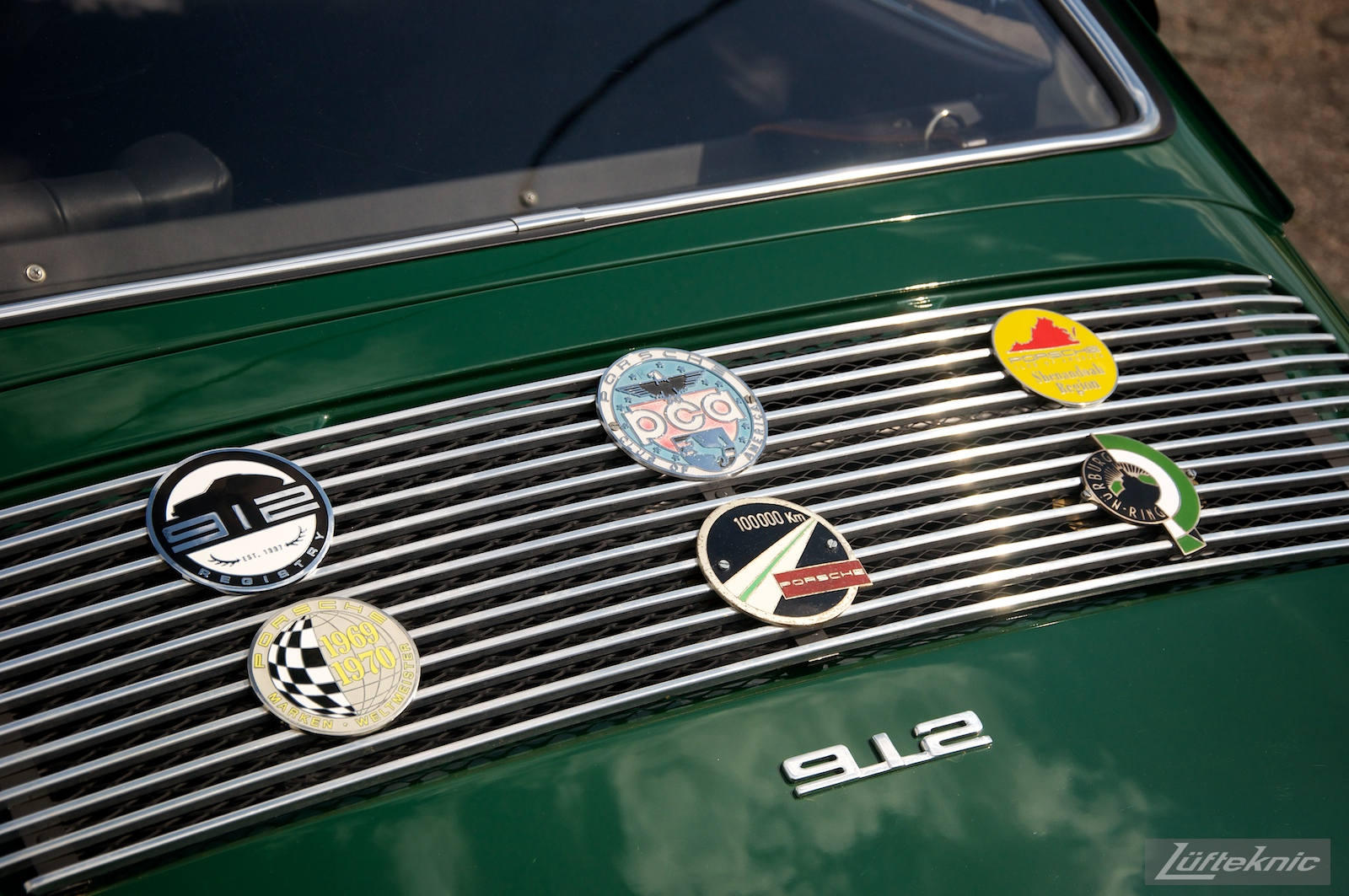 Grill flare on an Irish Green Porsche 912 which has been completely restored by Lufteknic sitting in the shop parking lot.