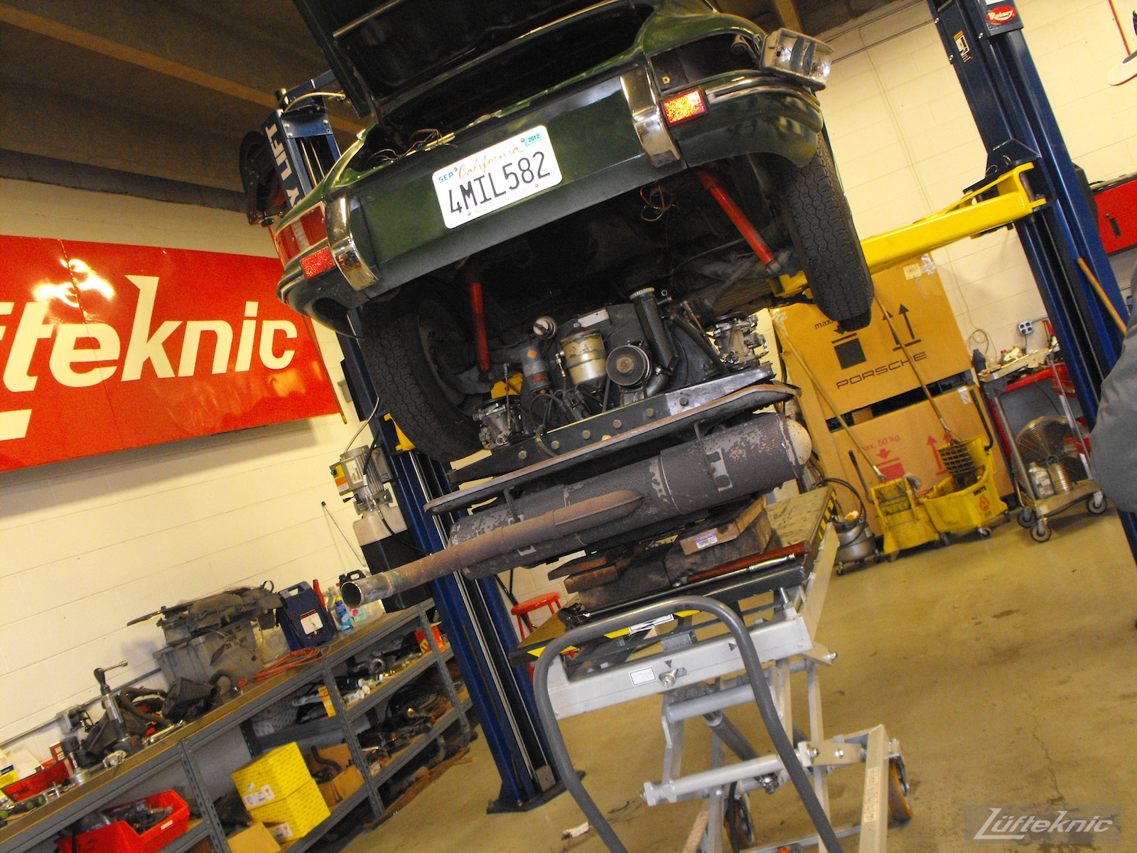 The engine being removed from an Irish Green Porsche 912 undergoing restoration at Lufteknic.