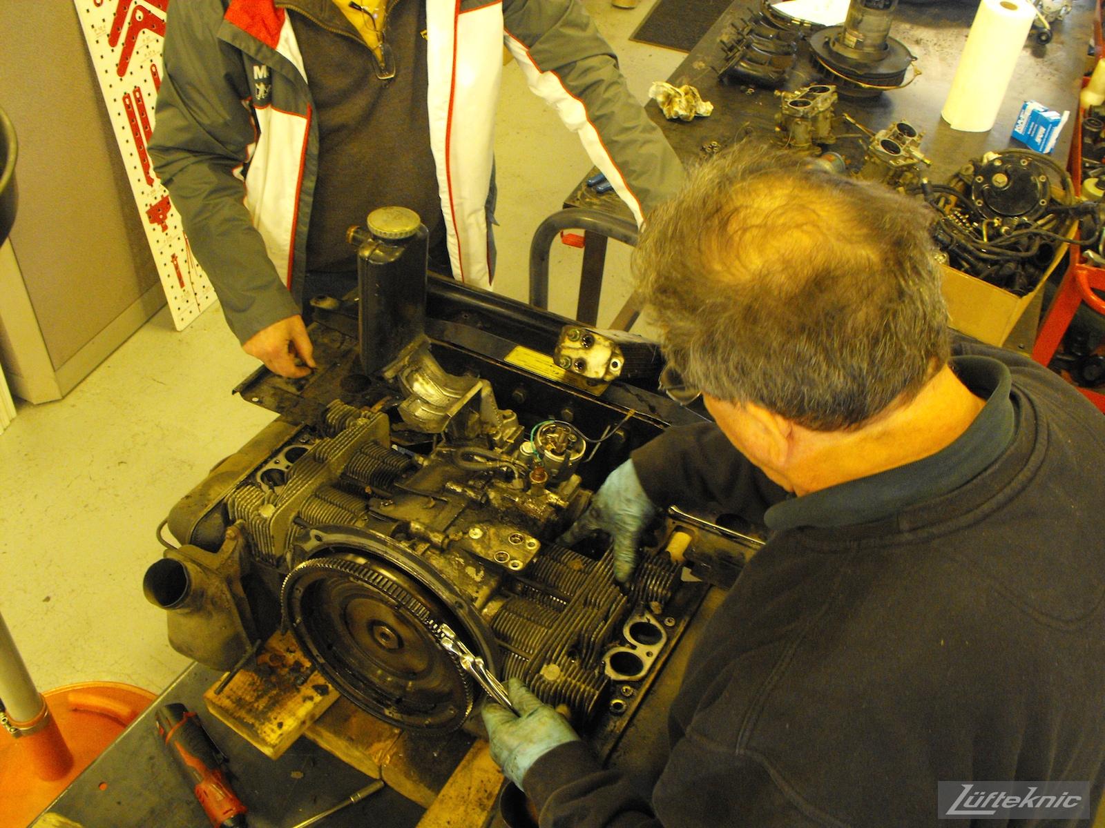 Engine disassembly begins on an Irish Green Porsche 912 undergoing restoration at Lufteknic.