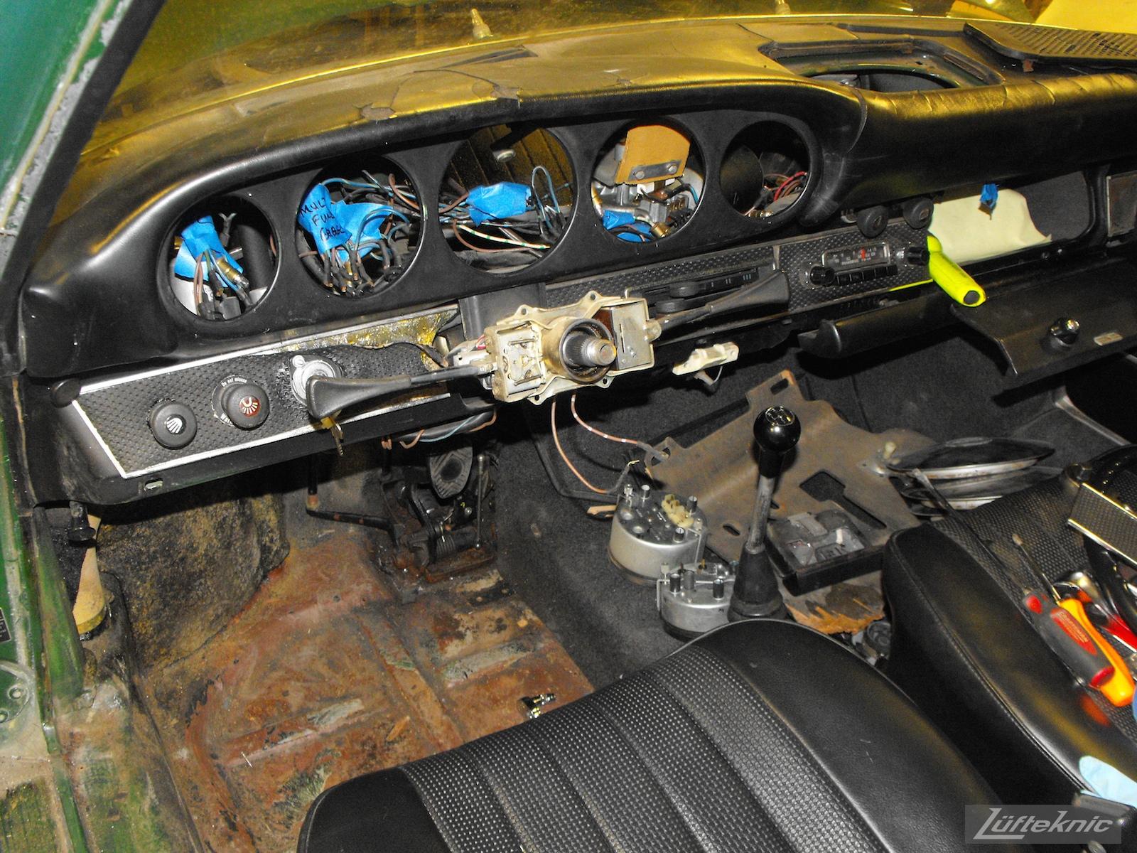 Stripped down dashboard and interior of an Irish Green Porsche 912 undergoing restoration at Lufteknic.