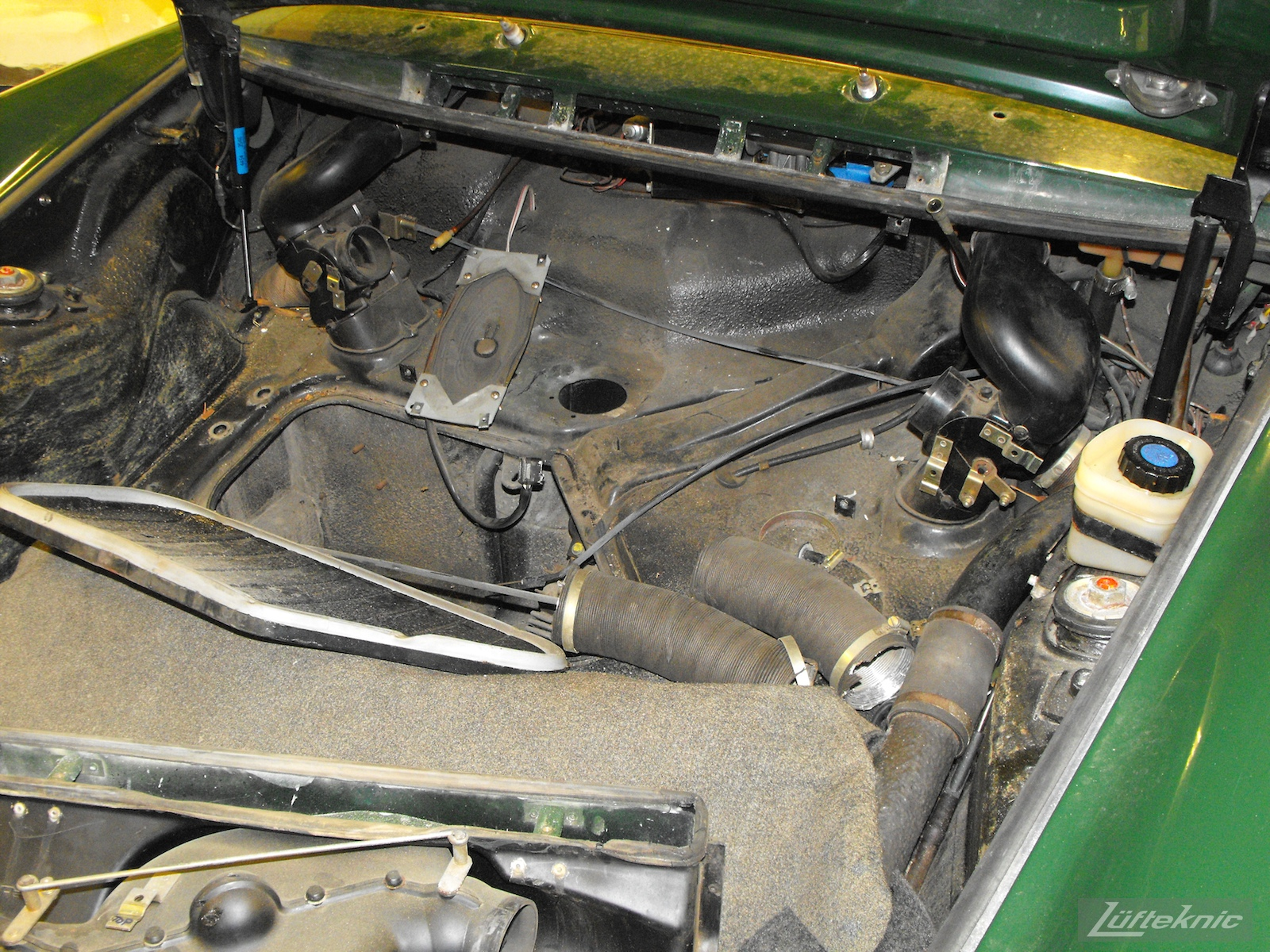 Under the hood of an Irish Green Porsche 912 undergoing restoration at Lufteknic.