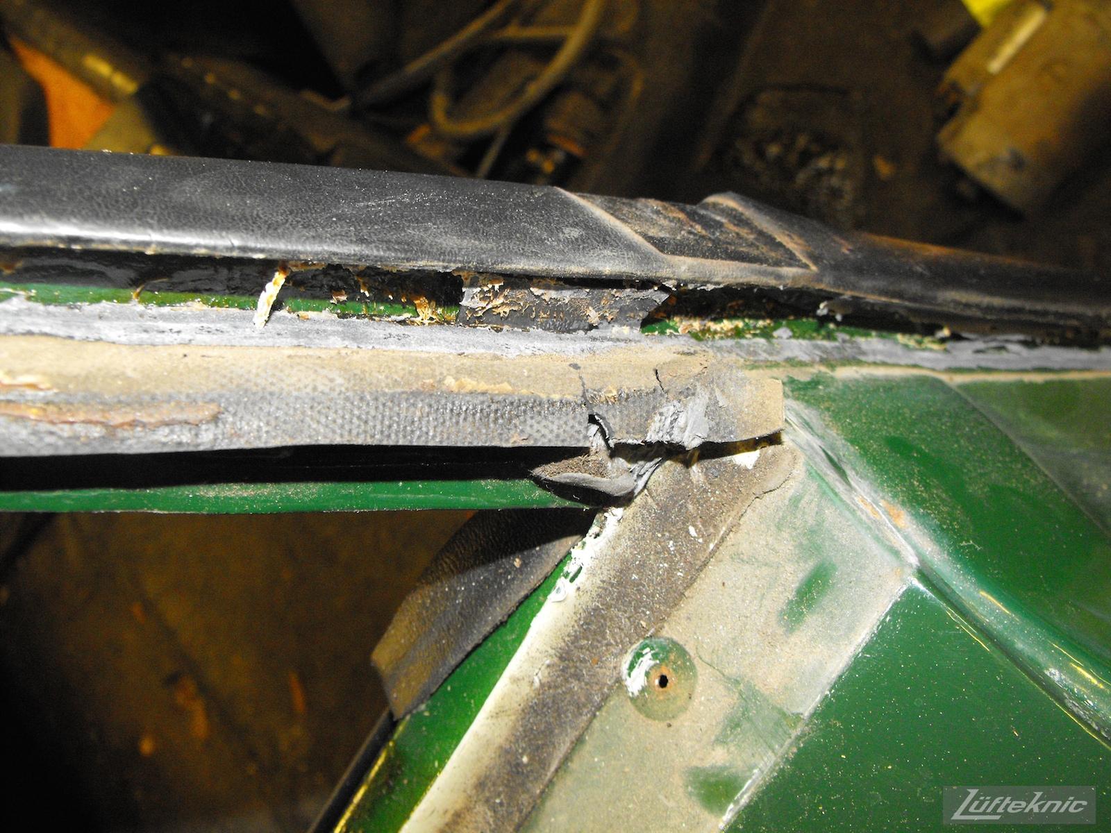 Aged parts and seals on an Irish Green Porsche 912 undergoing restoration at Lufteknic.
