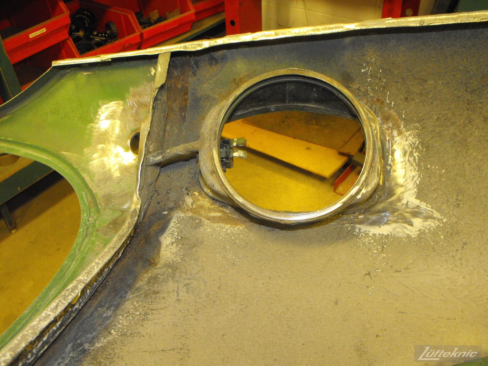 Front fender repair on an Irish Green Porsche 912 undergoing restoration at Lufteknic.