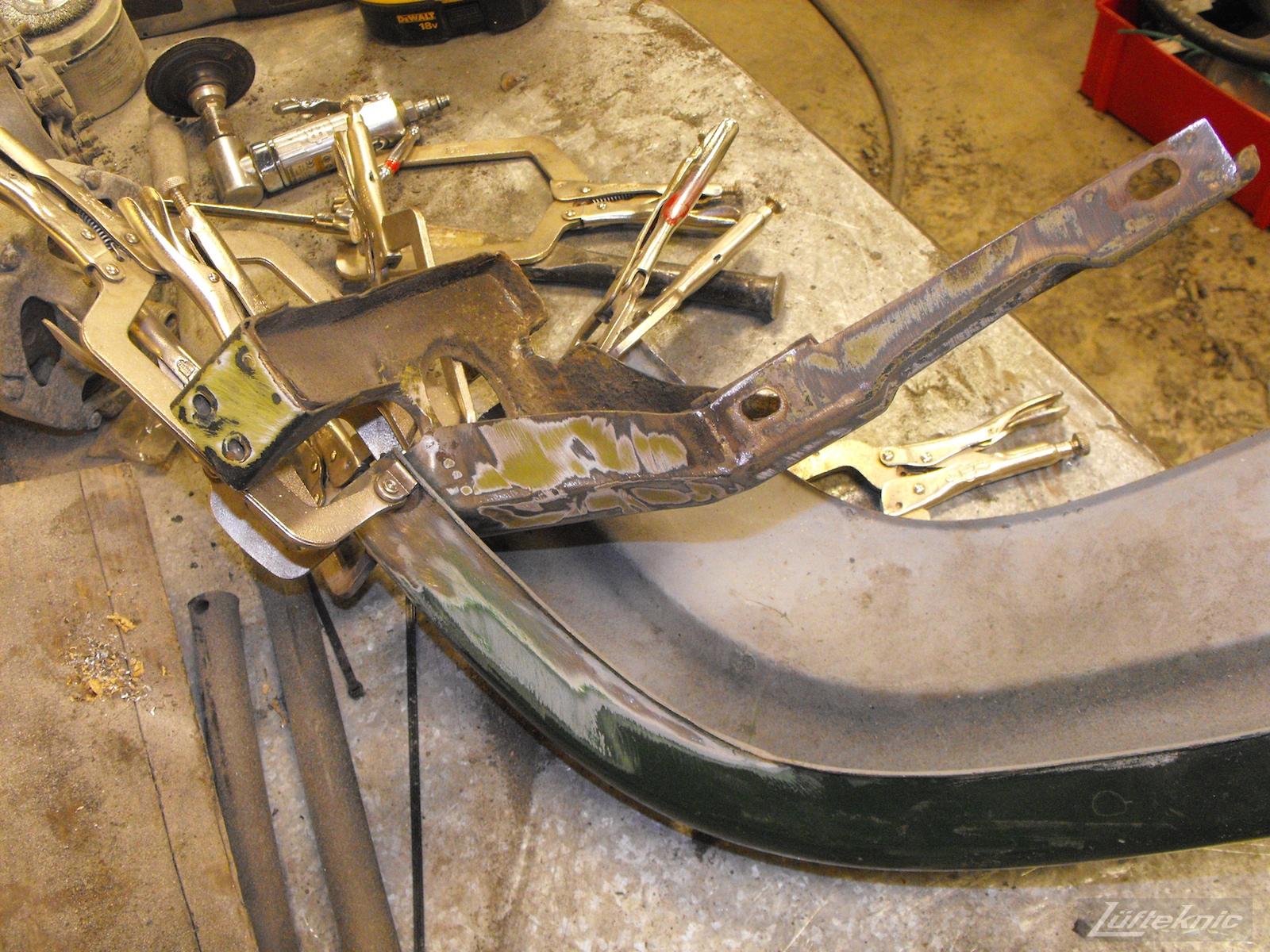 Front bumper repair on an Irish Green Porsche 912 undergoing restoration at Lufteknic.