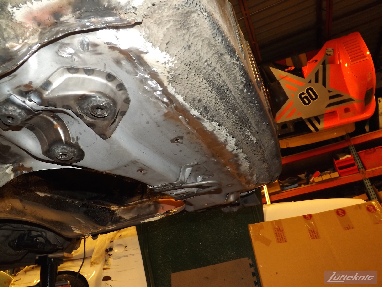 Fresh front pan installed on an Irish Green Porsche 912 undergoing restoration at Lufteknic.