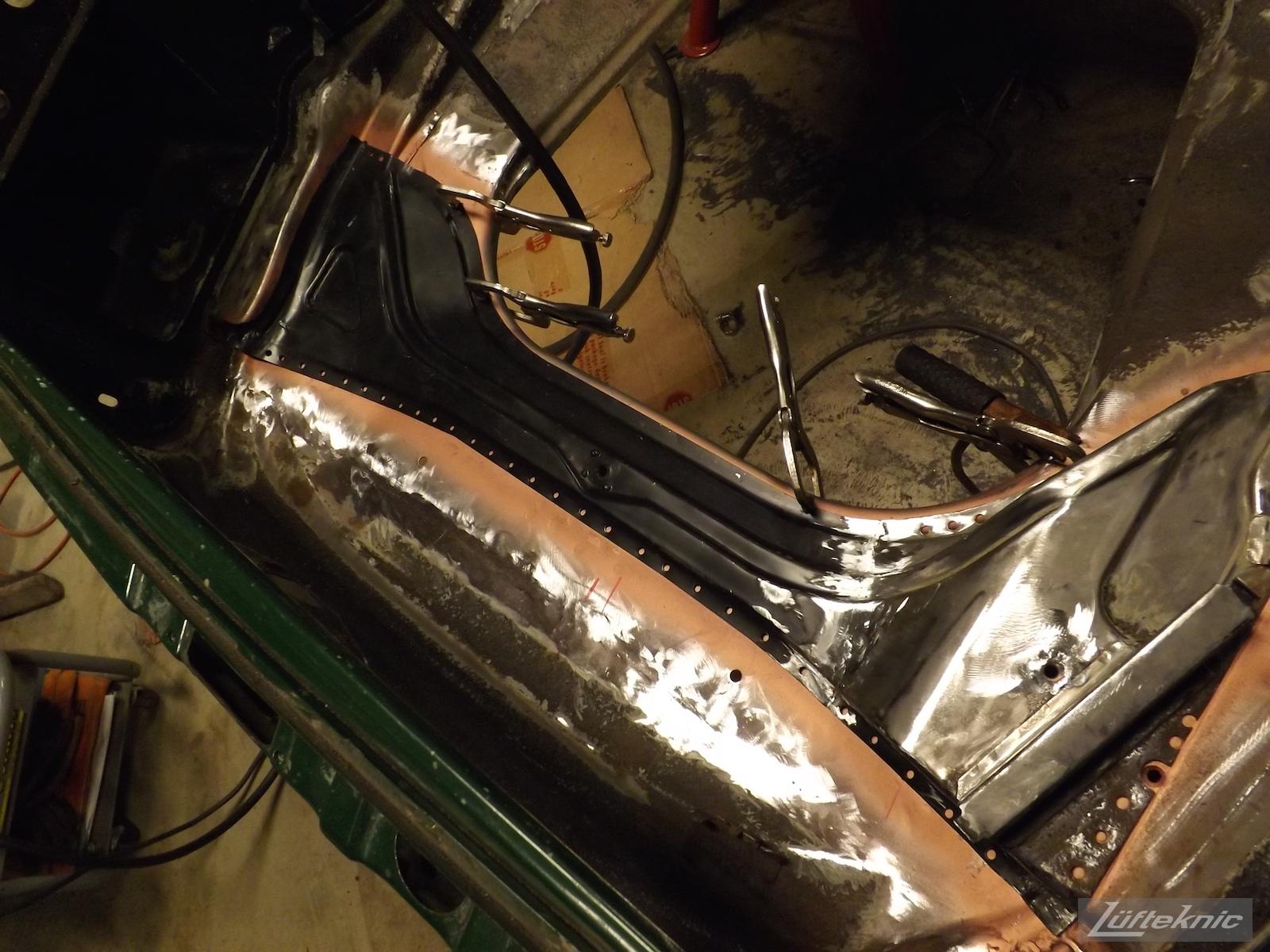 Finishing the layers of metal on an Irish Green Porsche 912 undergoing restoration at Lufteknic.